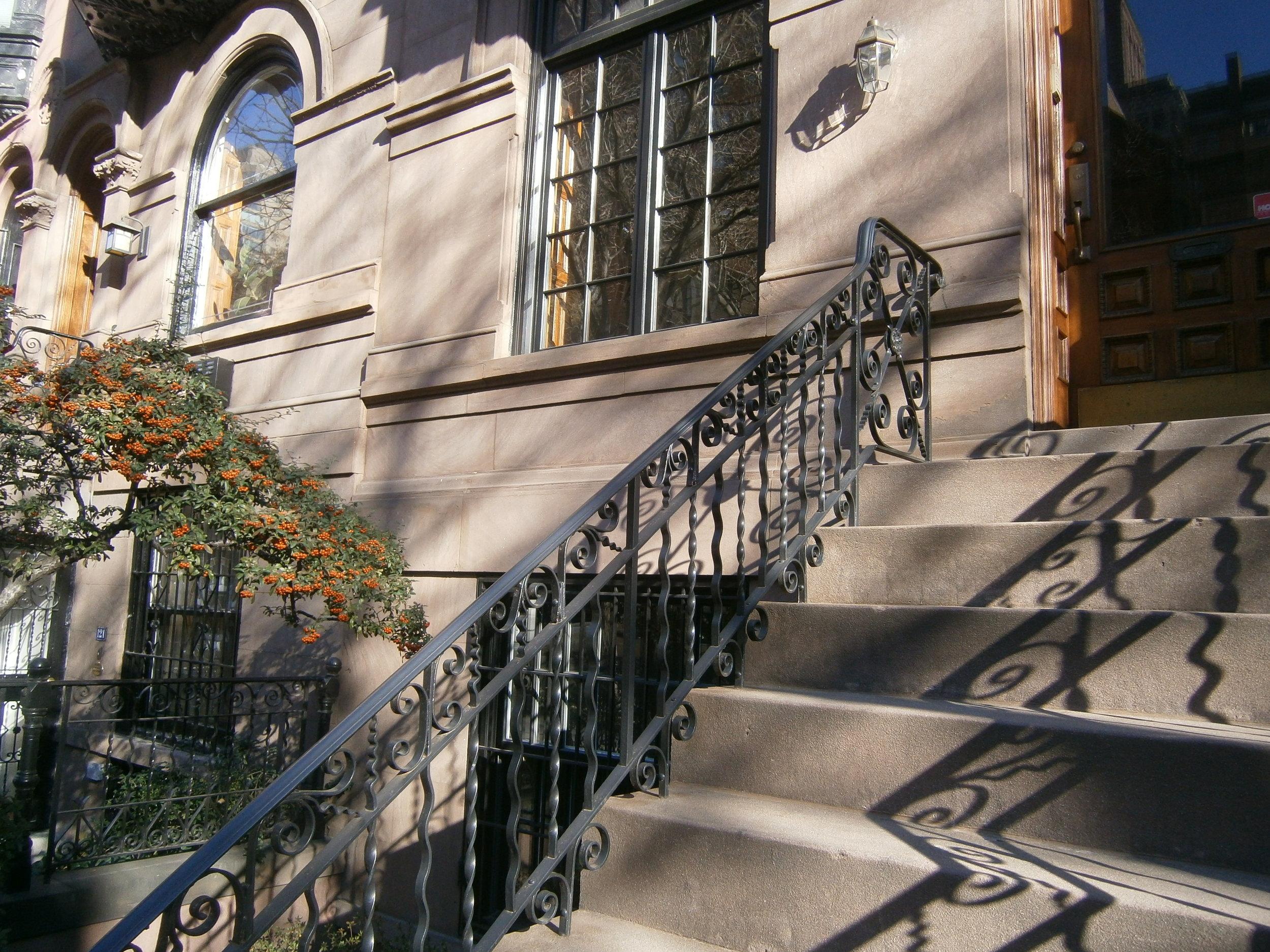 Hand railing on brownstone in historic district LPC.JPG