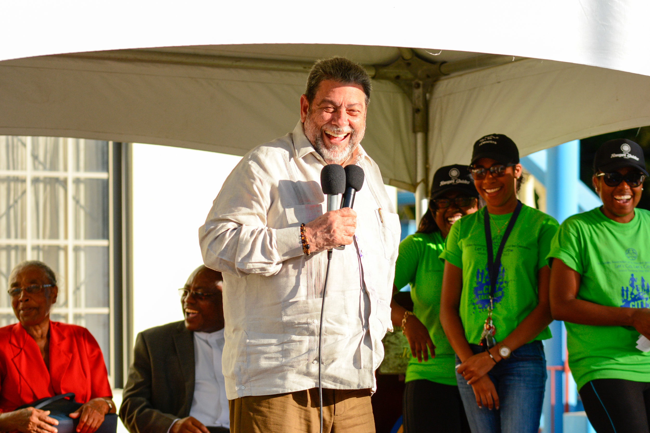 Dr. Hon. Ralph Gonsalves pays a surprise visit to the Girl Guides walk, greeted by smiles all around.