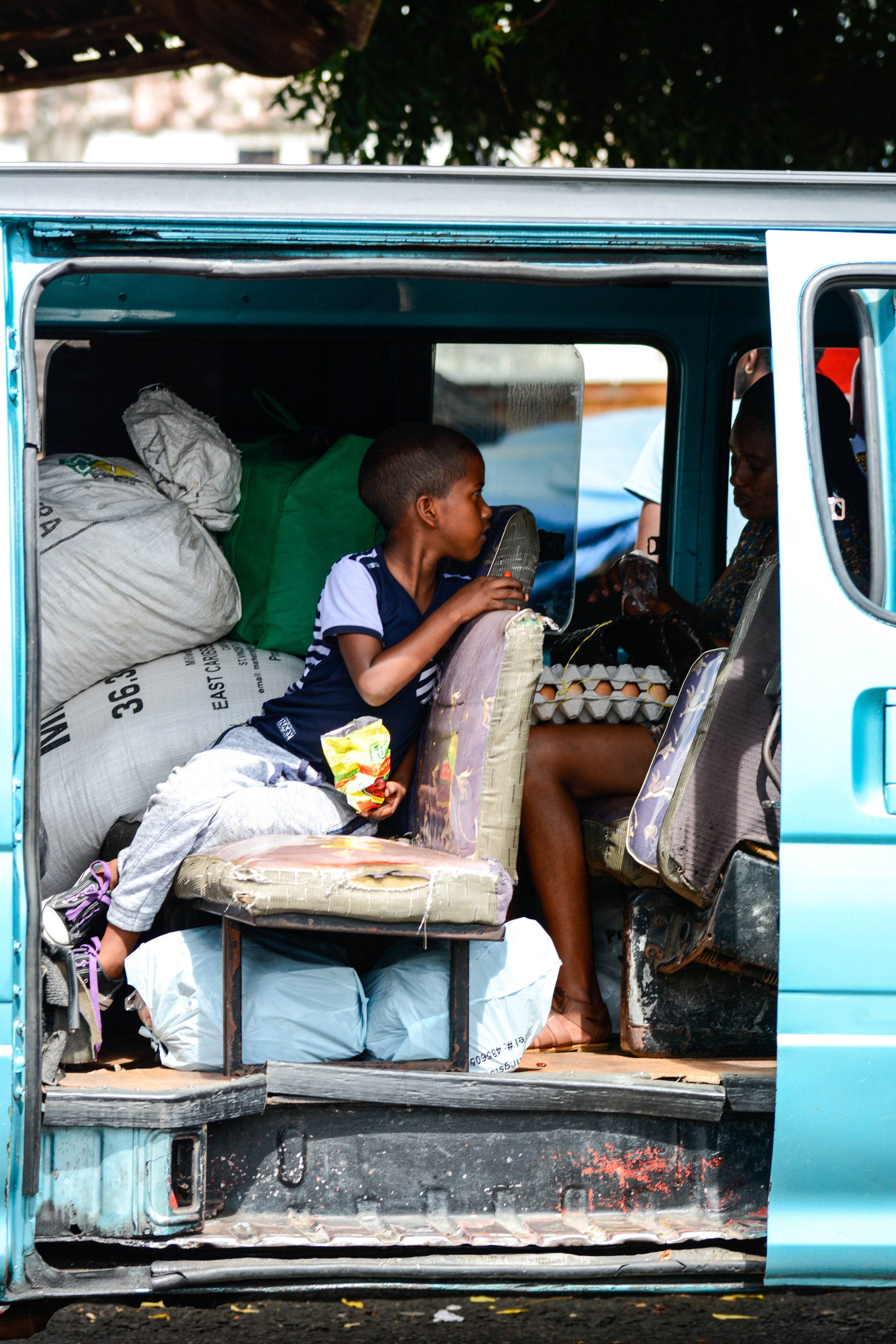 You can tell when the vans are headed to the country side because the passengers load up with heavy cargo as they make their weekly trips into town. Many of these people have to carry their flour sacks full of food up mountain paths to their homes.