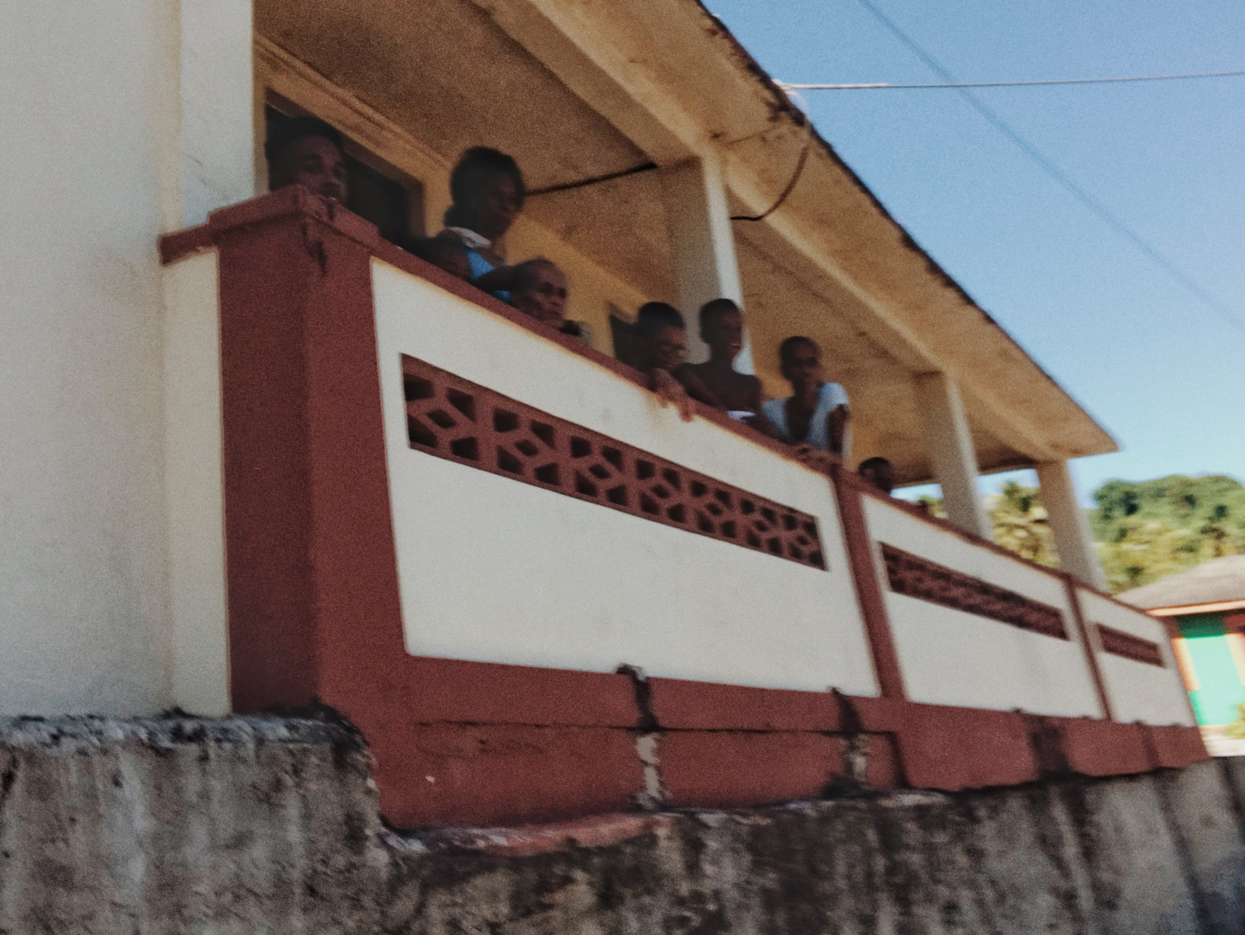 Audience on a Roadside Porch