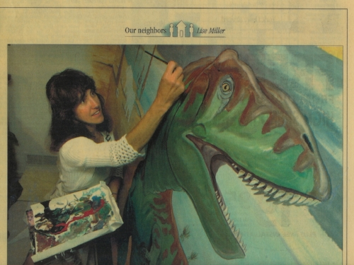 Following her calling, Lise' painting a Dinosaur Mural.Photo in York Daily Record 2003.jpg