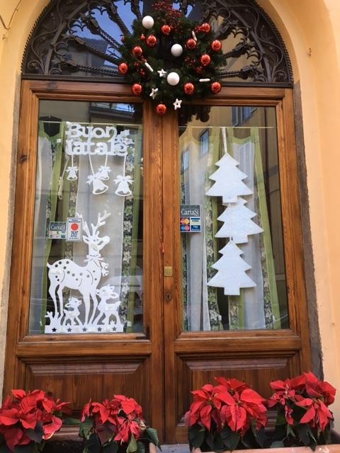 Restaurant window just off Via San Giorgio, Lucca, December 2016.