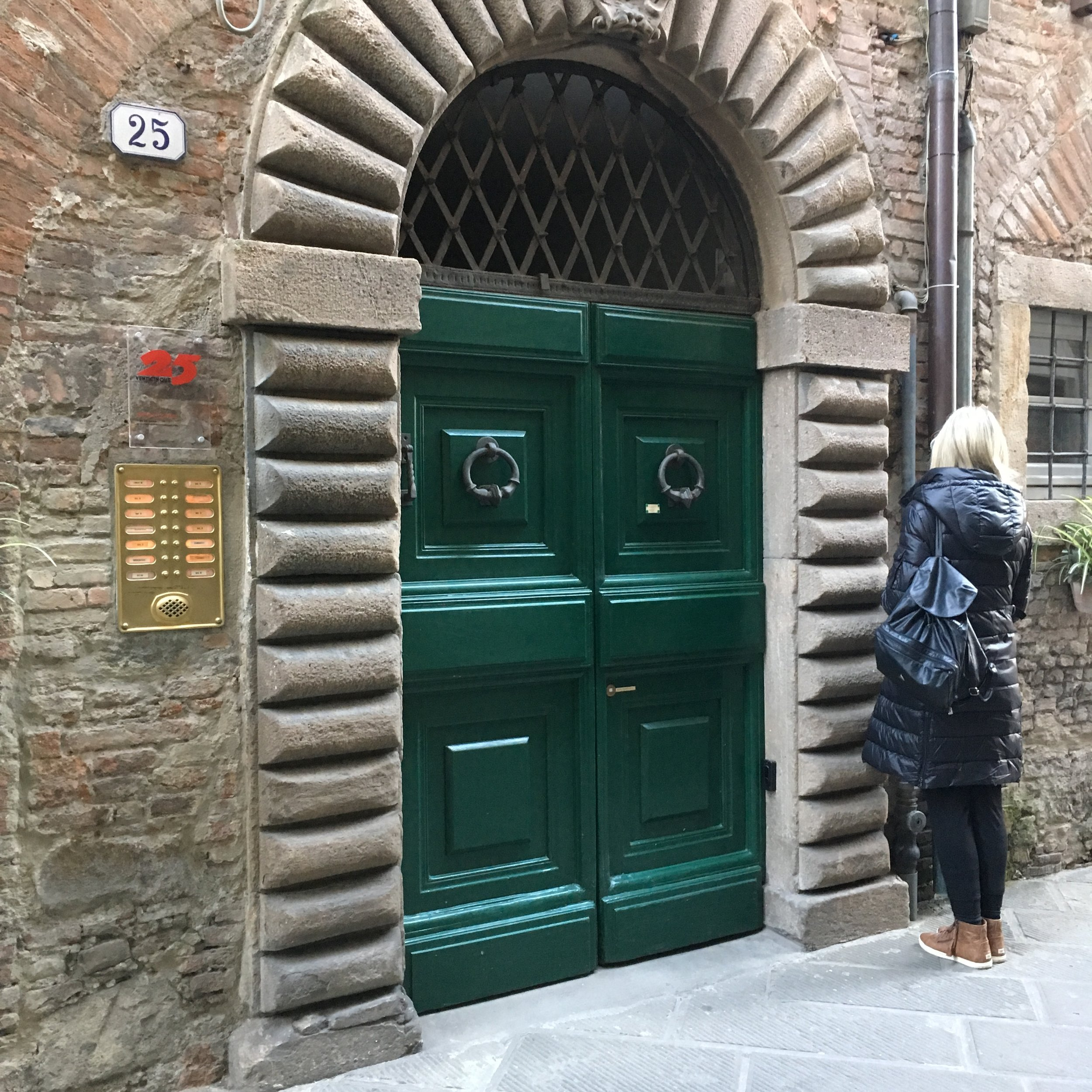 Judy at the front door to the apartment on Via Pelleria in Lucca.