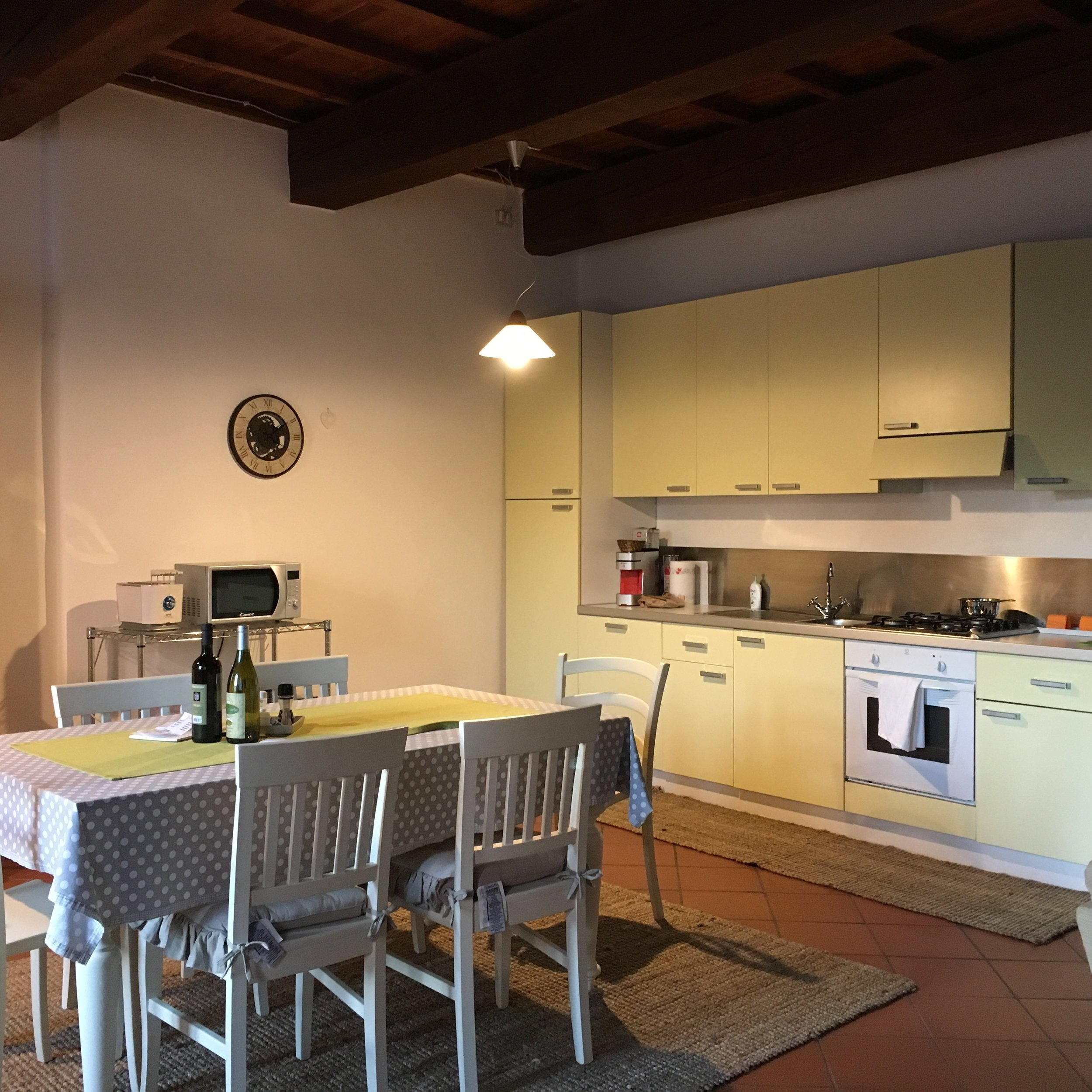 The galley kitchen is well-equipped and the cabinets stocked with cookware and dishes.