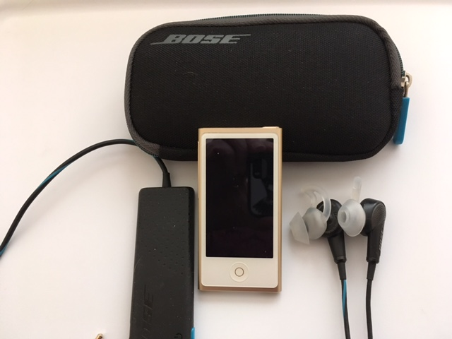 The iPod nano with BOSE noise-canceling earbuds - small, lightweight, and it provides hours of music.