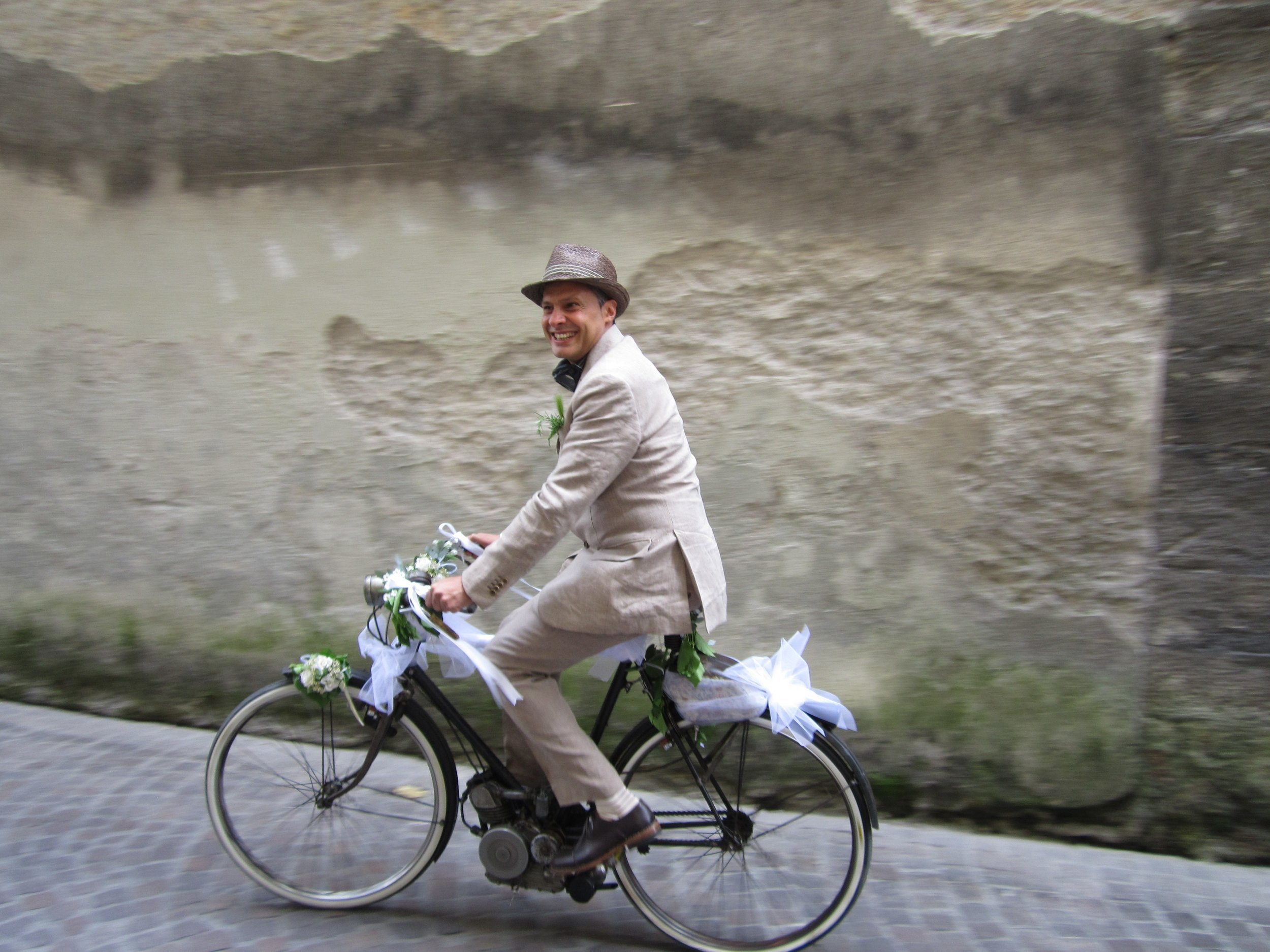 One of my all-time favorite photos - a groom on the way to his spring wedding, Lucca, 2012.