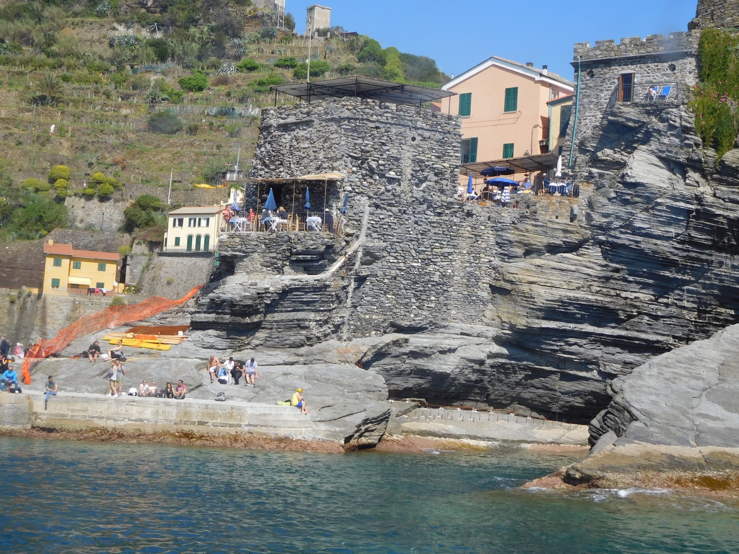 The sea approach to Vernazza and the remains of a defensive tower, now housing a restaurant.