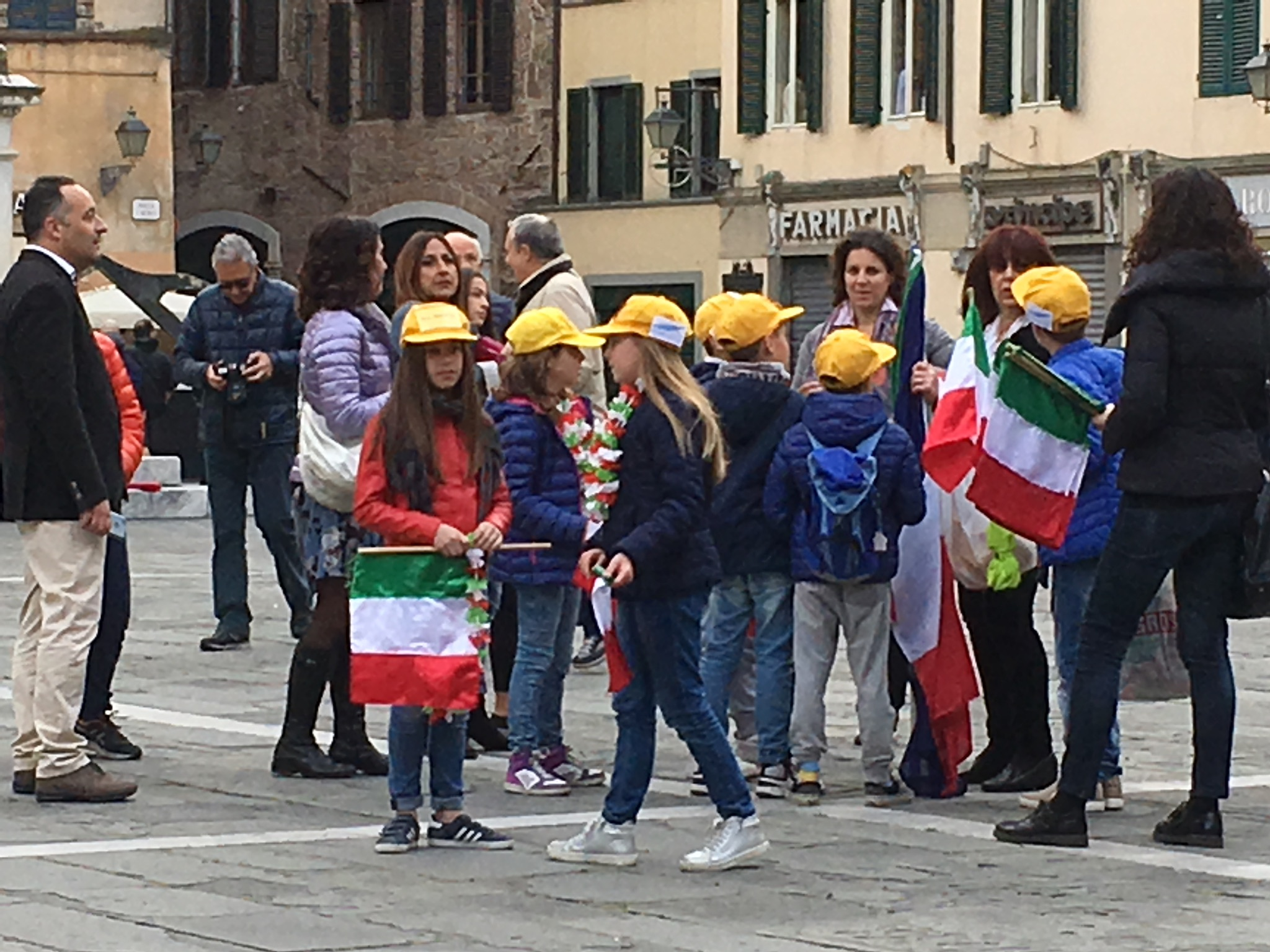 Children gather in Piazza San Michele, Lucca, for the Liberation Day ceremony.