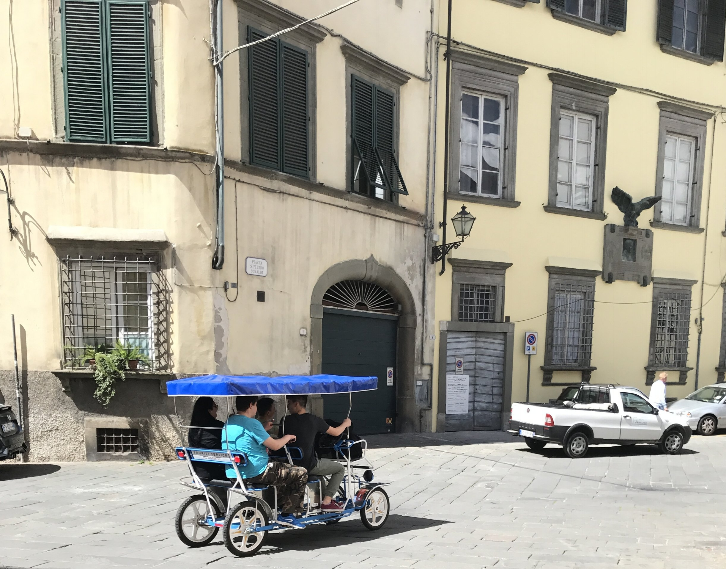 Kids pedal their way through town.
