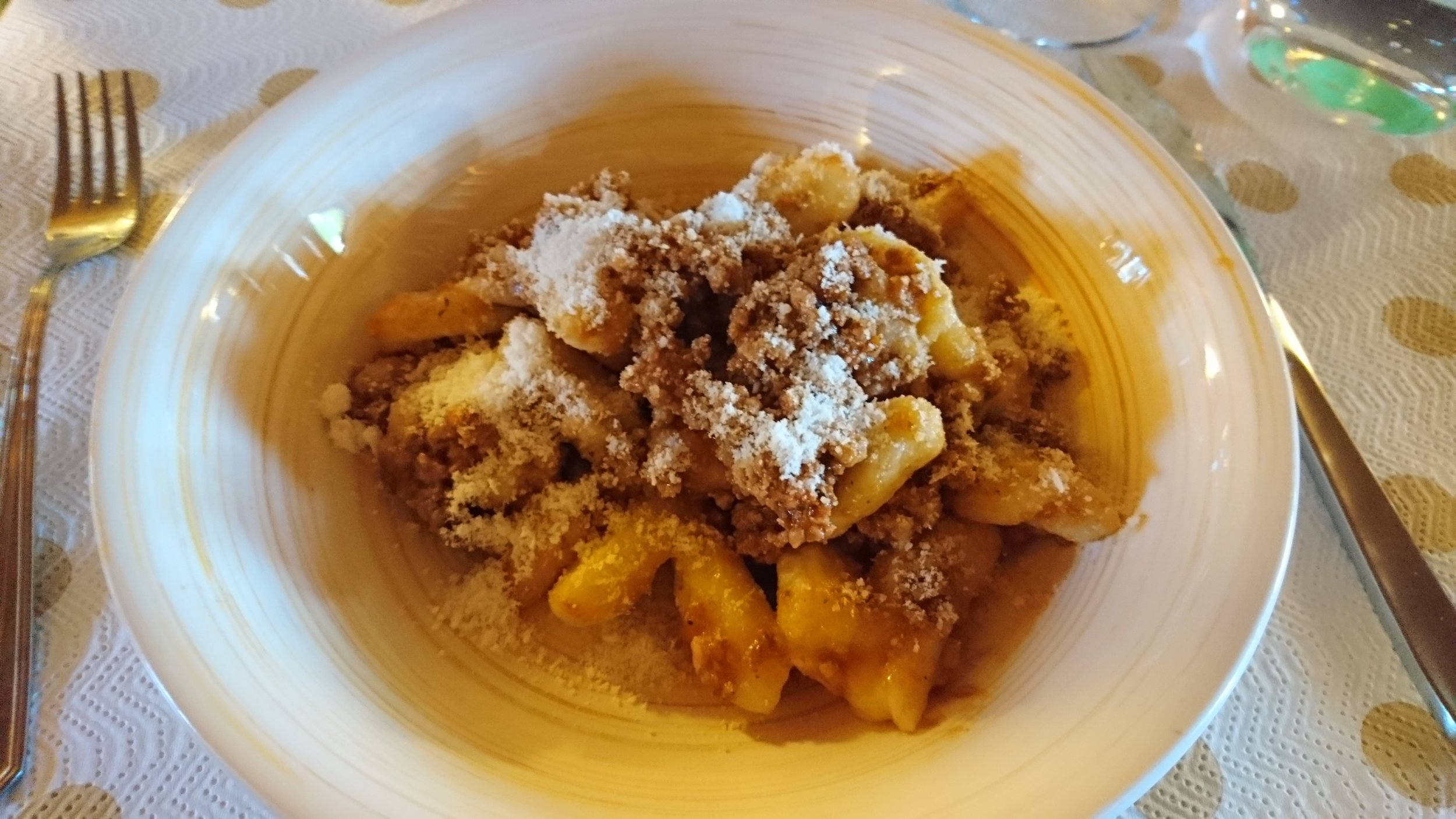 Finished gnocchi topped with ragu.