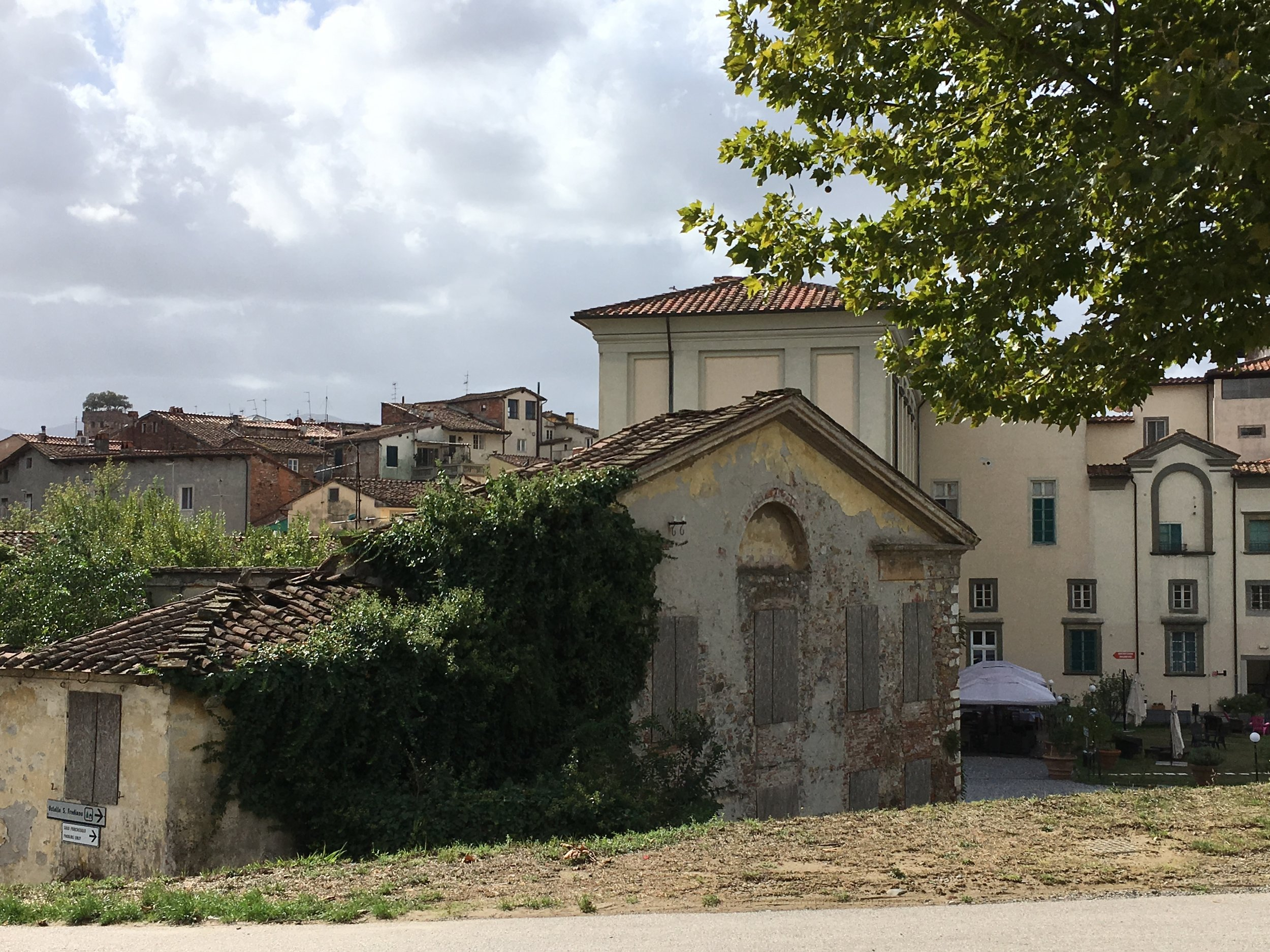A beautiful unrestored building as seen from le mura (the wall).