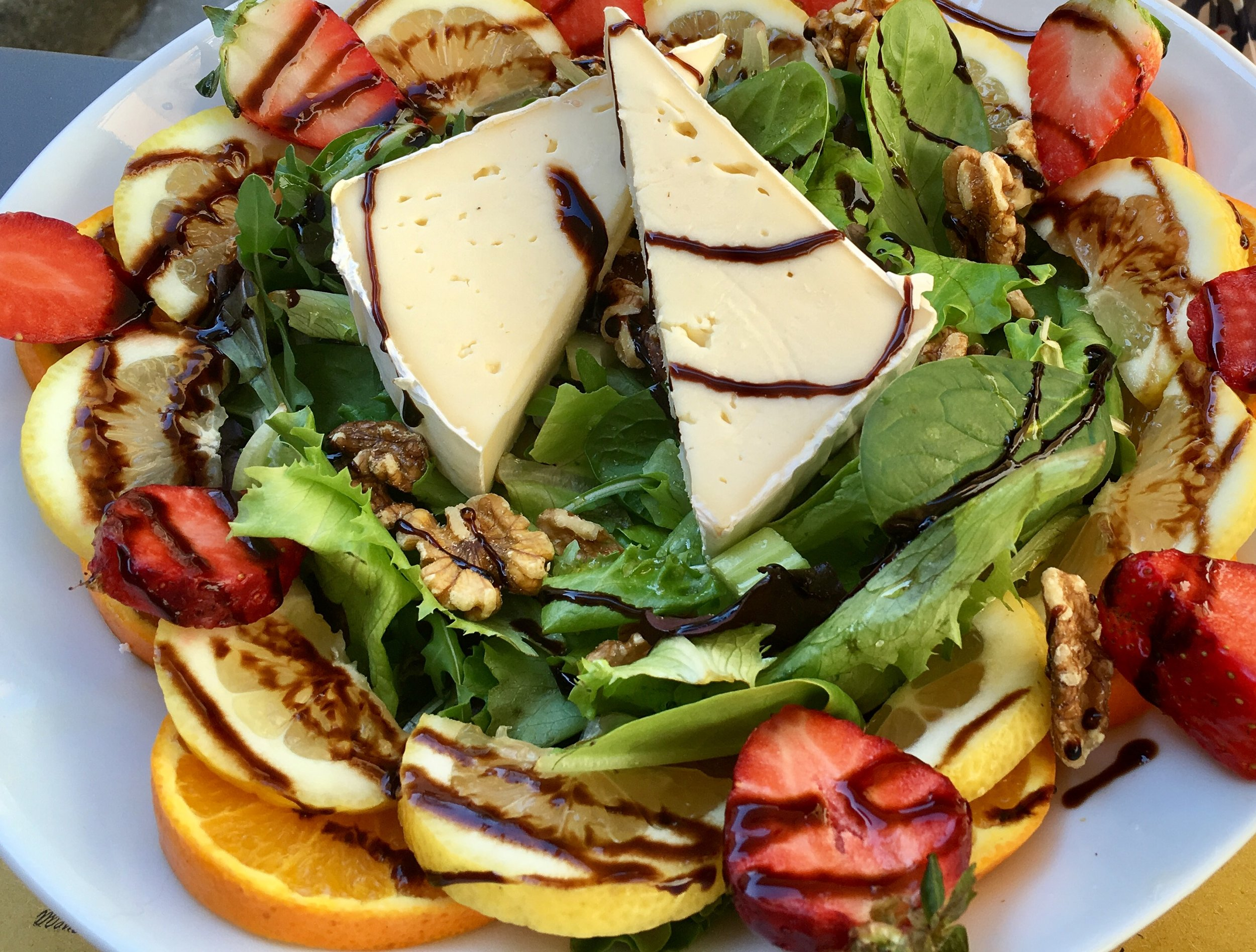 A meal-size salad with fruit, cheese, nuts and a balsamic glaze, Santa Cristina Enoteca, Lucca.