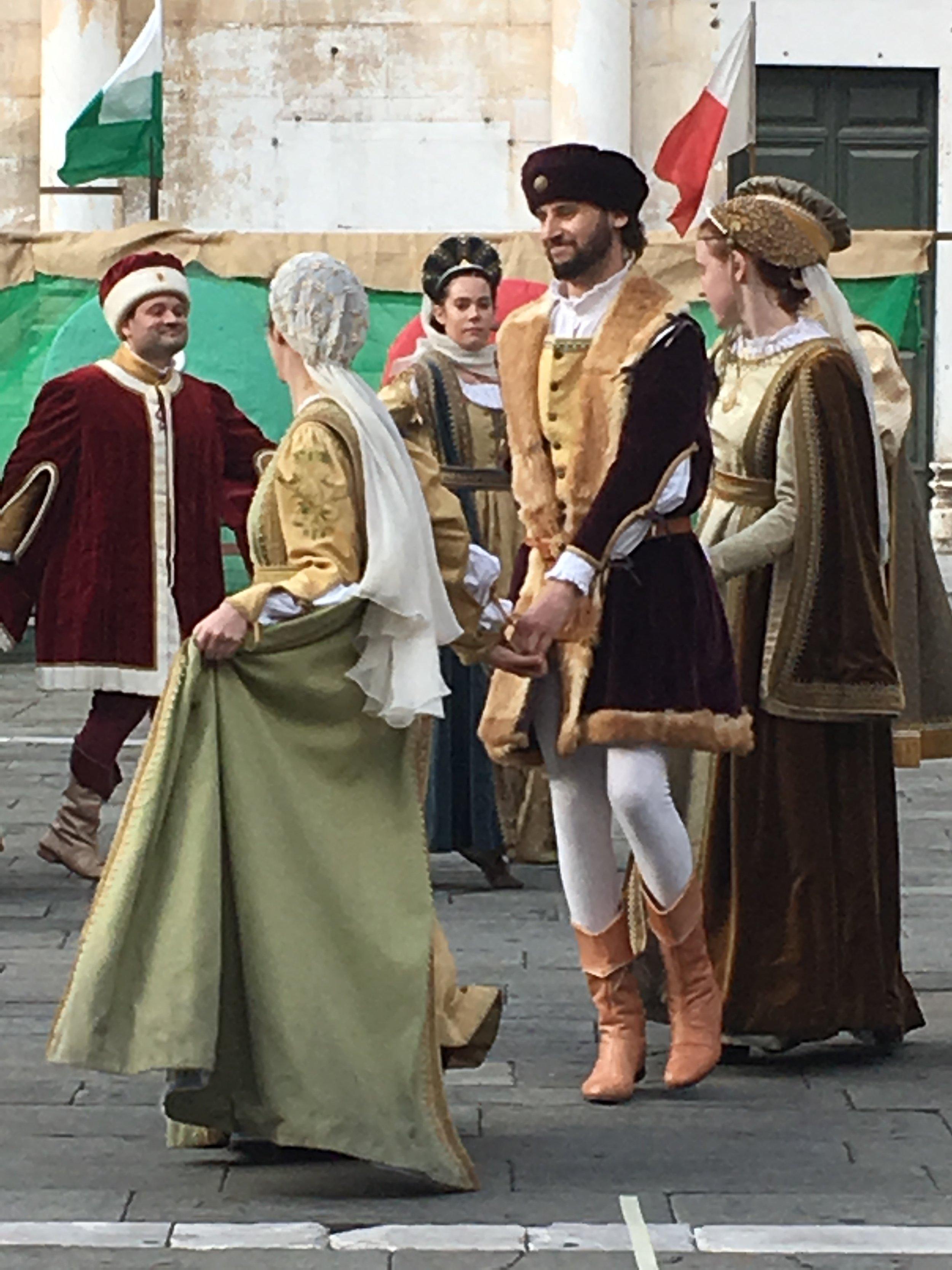 Dancers in medieval costume.