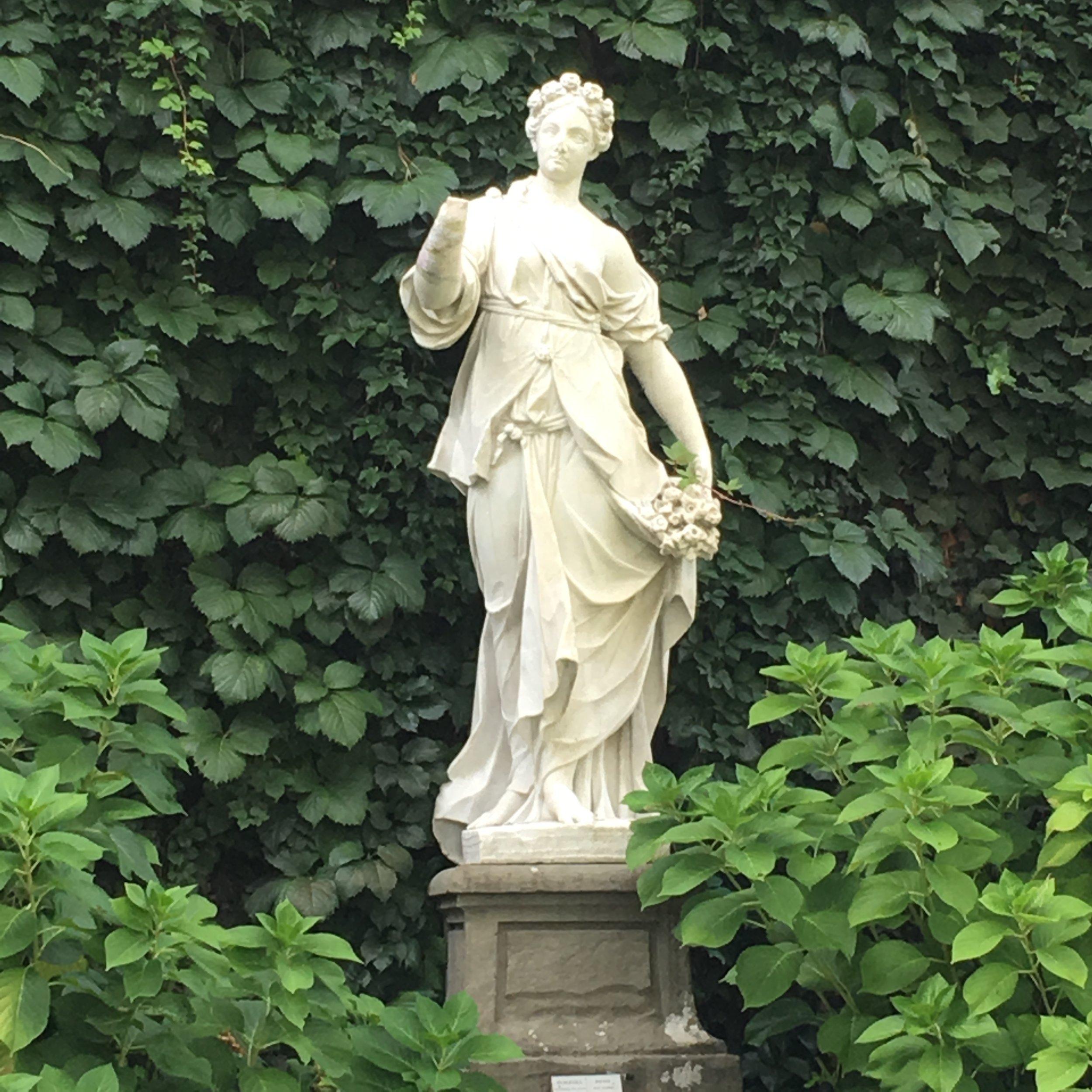 Statue of Spring ( Primavera ), garden of Palazzo Pfanner.
