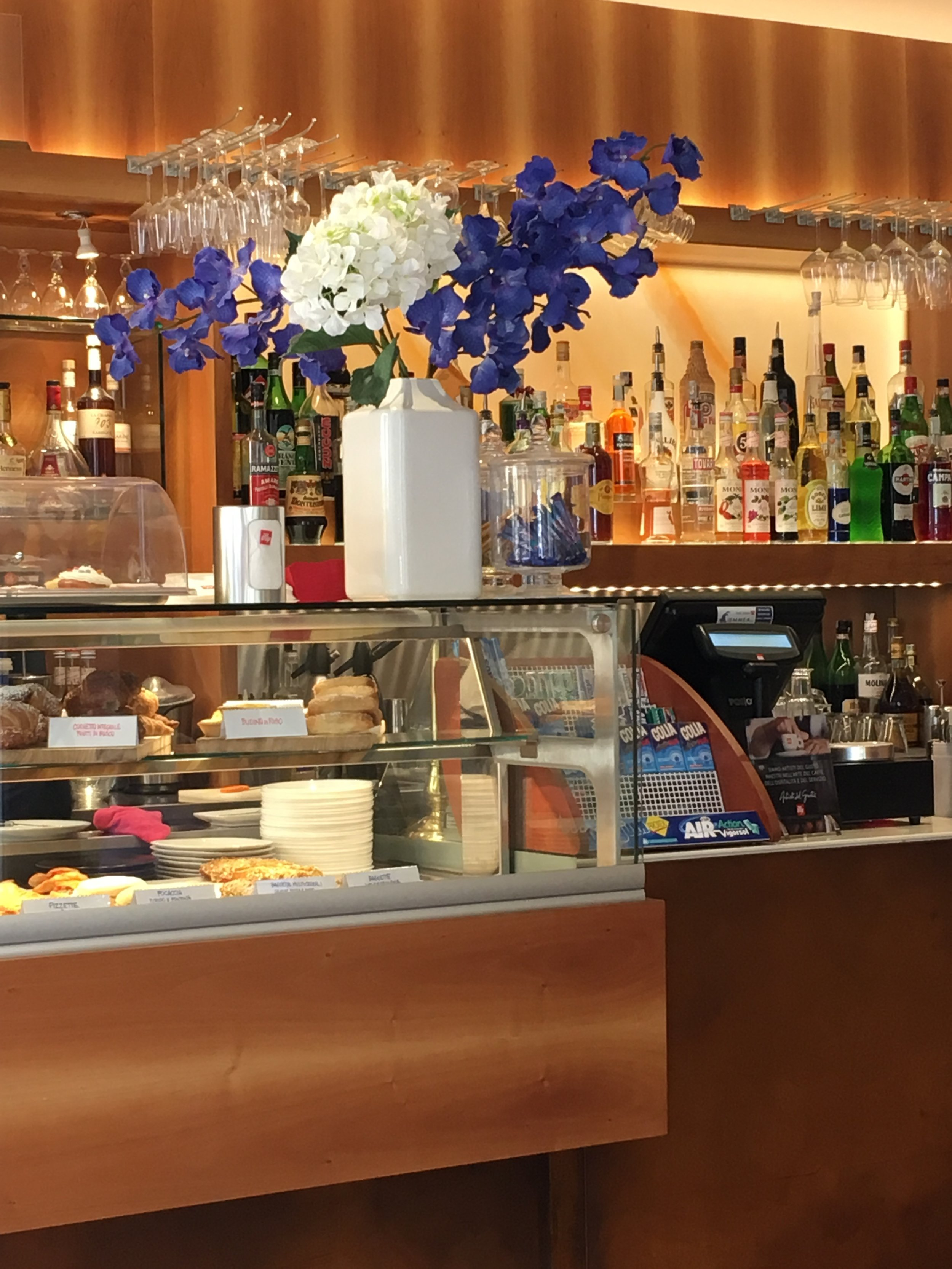 The pretty counter is a perfect place to sip your espresso Italian style, standing at the bar.