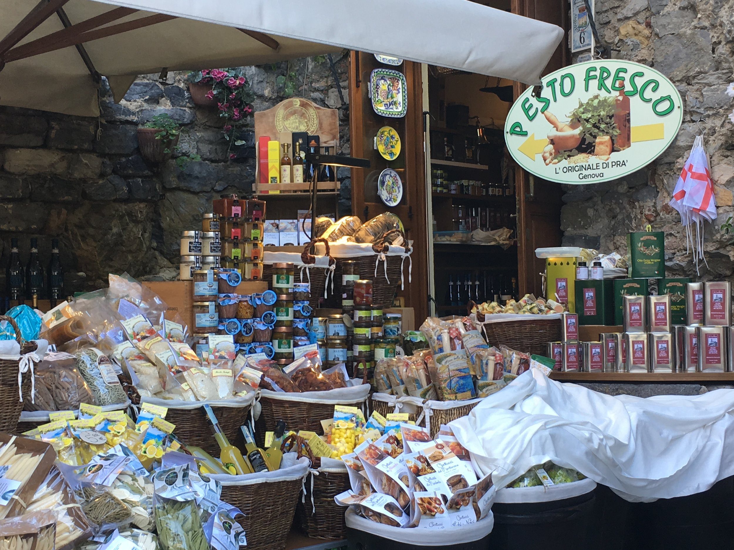 A market in Porto Venere, Liguria, selling pesto and trofie along with other local specialties