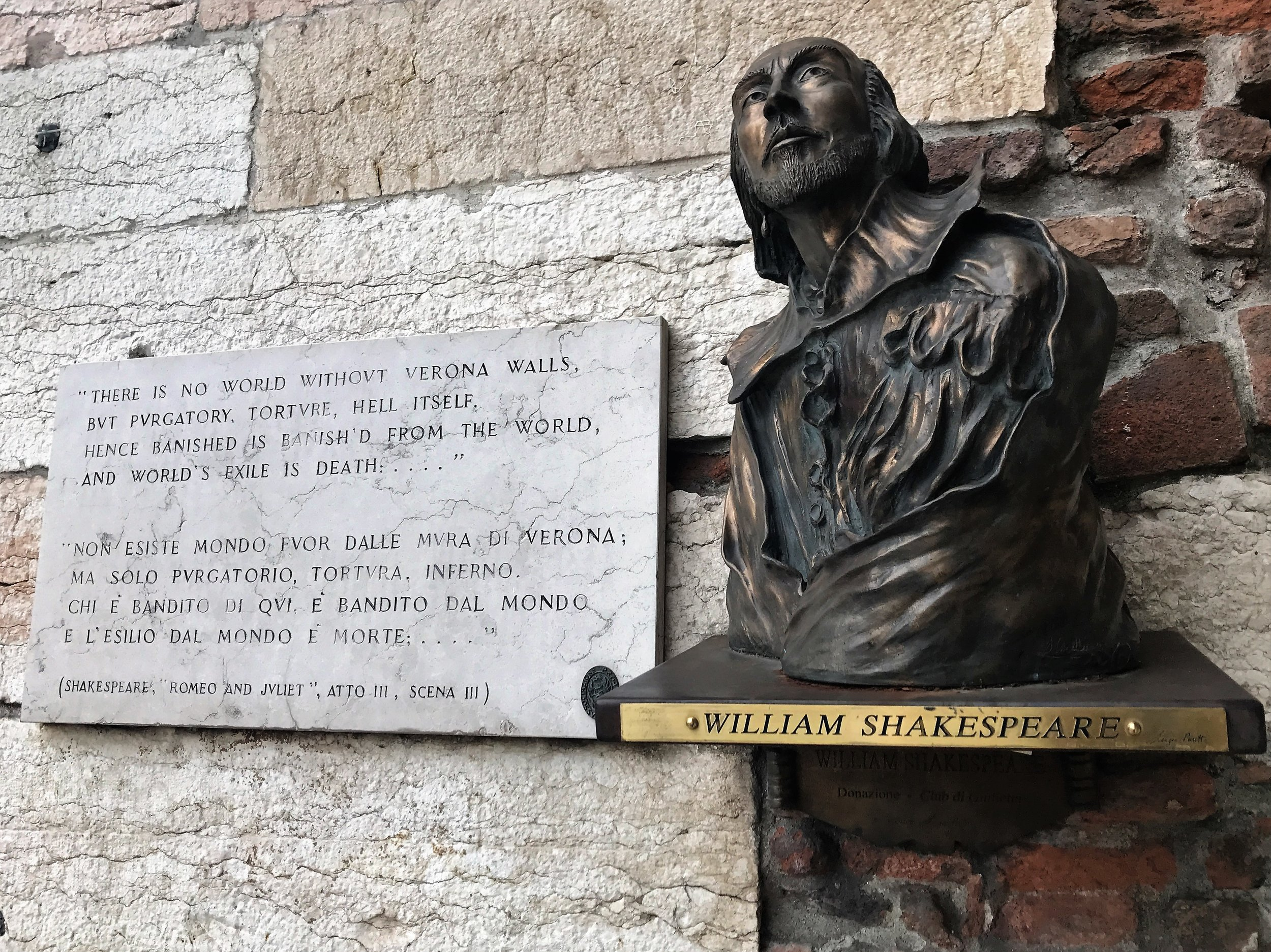 Shakespeare's likeness and words on a wall in Verona