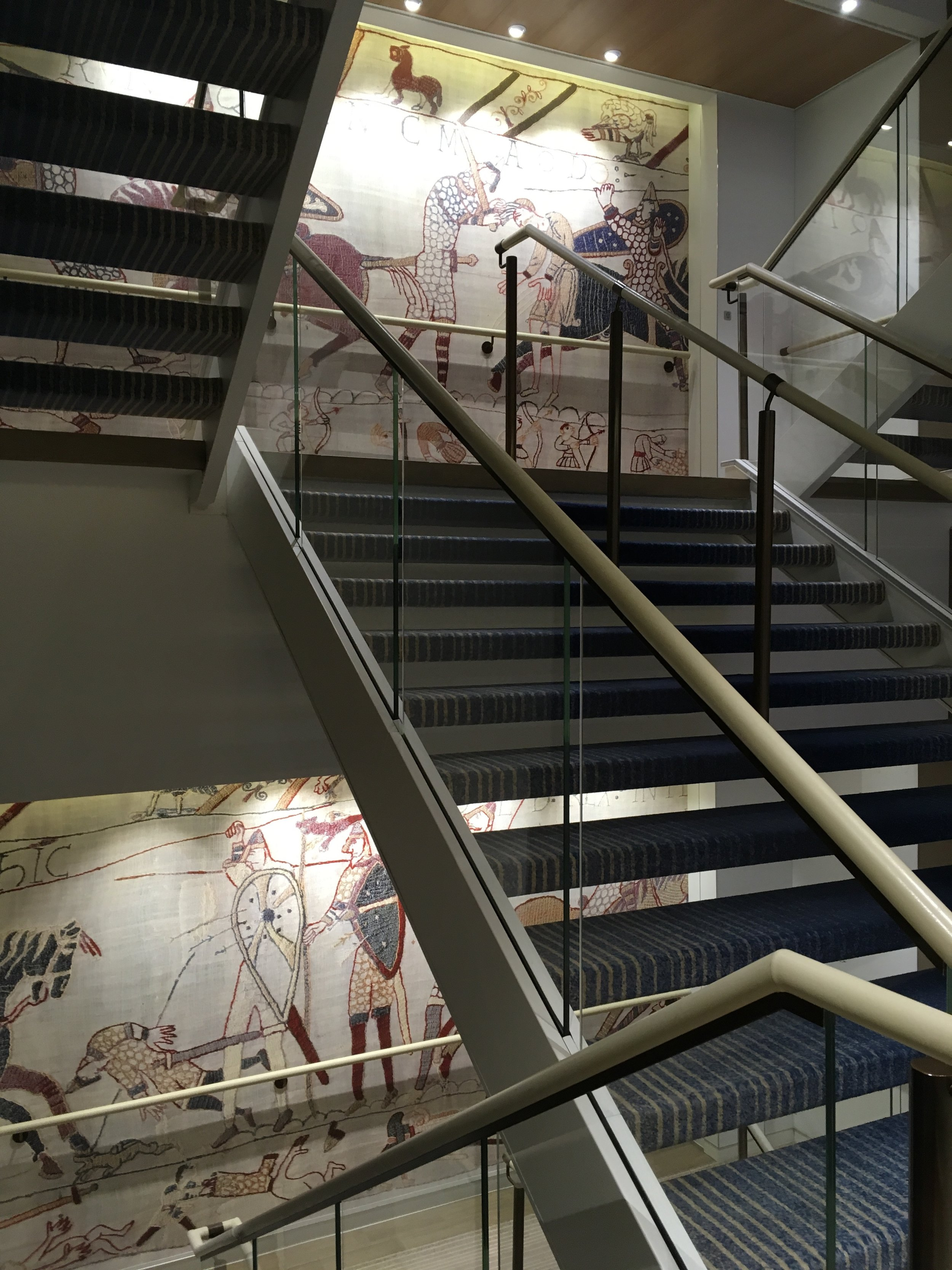Sections of the Bayeux tapestry line the staircase landings