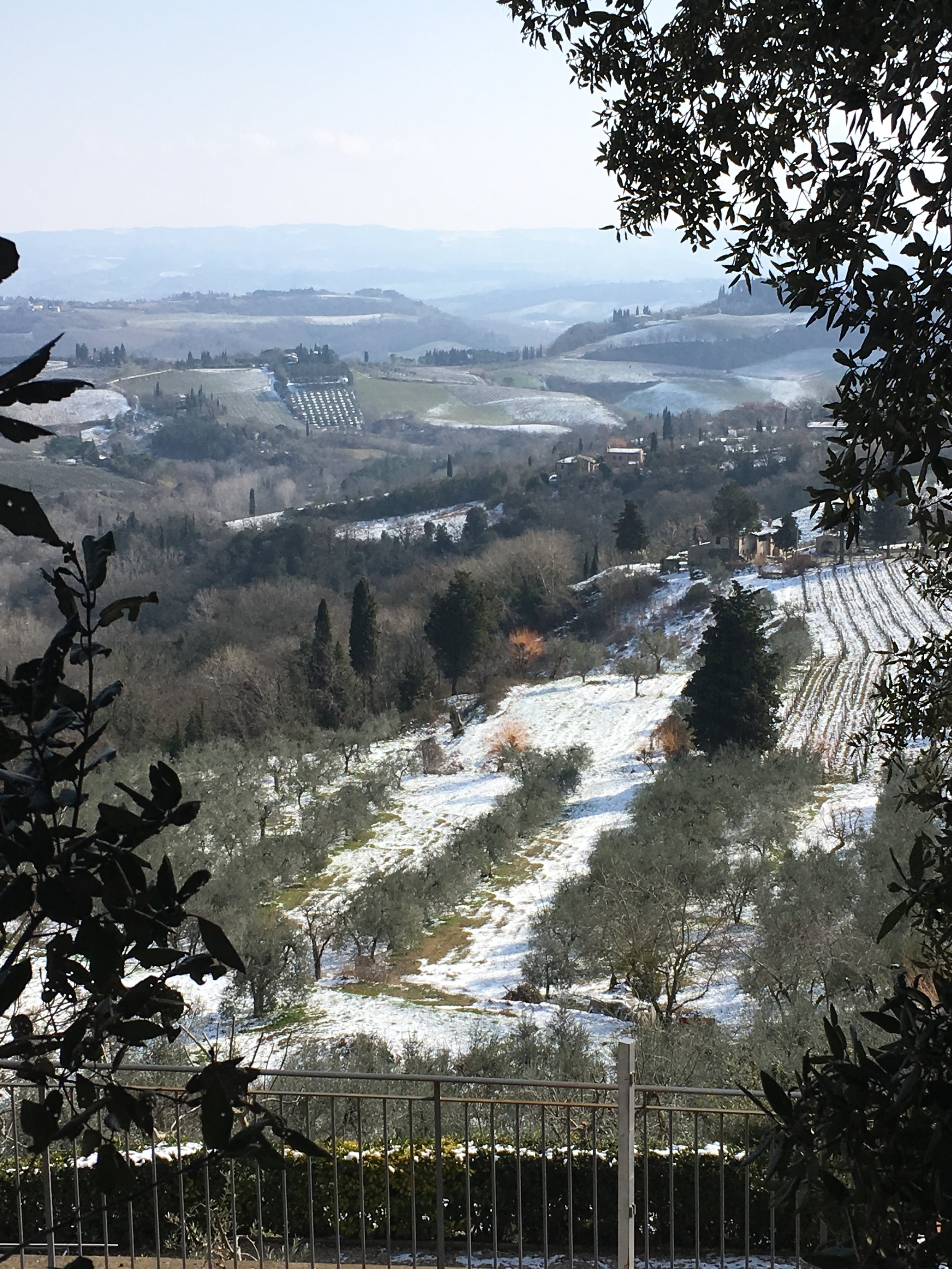 Tuscan hillsides covered in a late winter snow