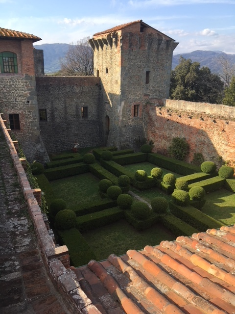 The Italian garden lies between the oldest and newer portions of the fortezza .