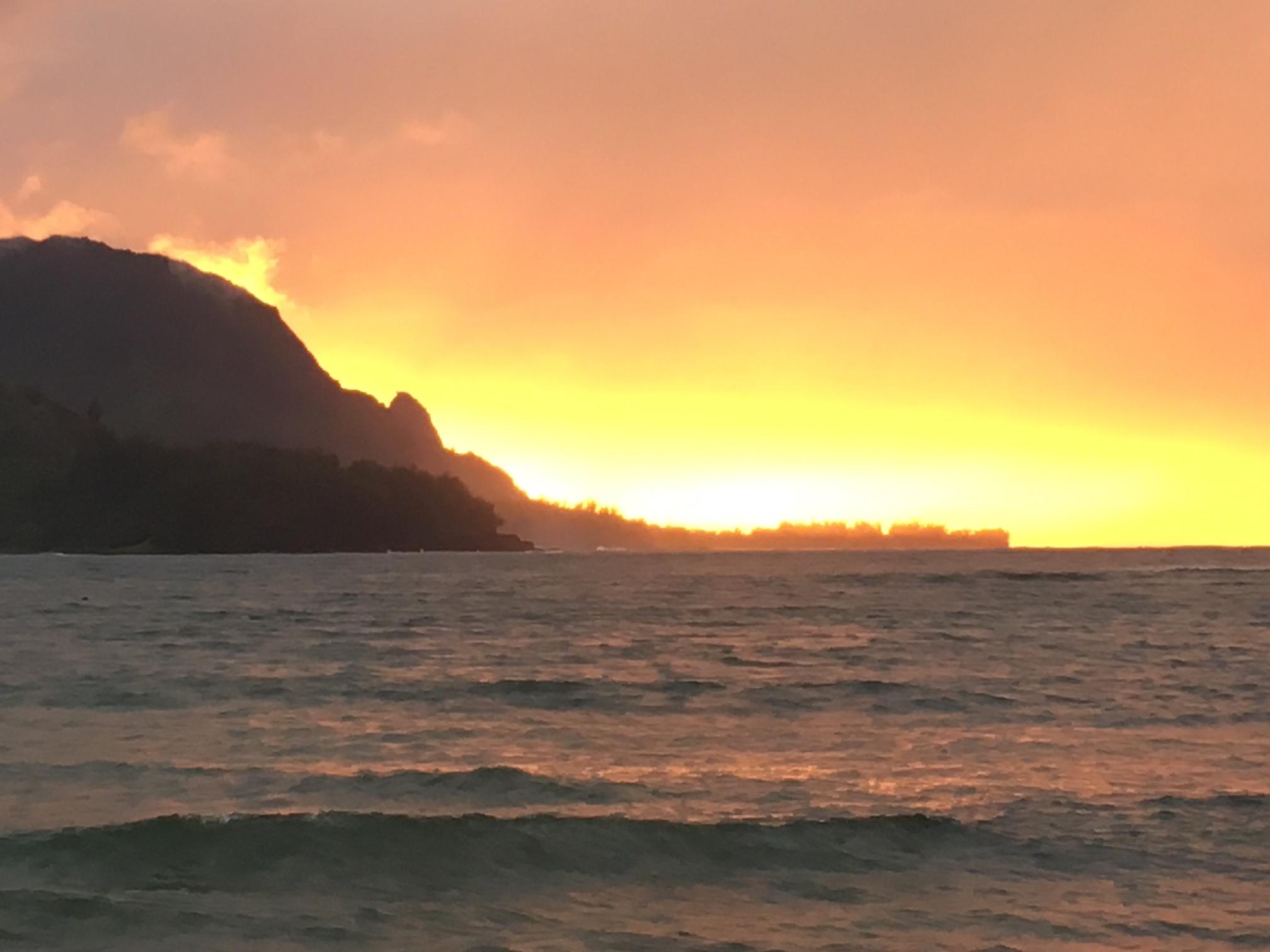 The sun sets in Kauai (photo by Ann Hettinger).