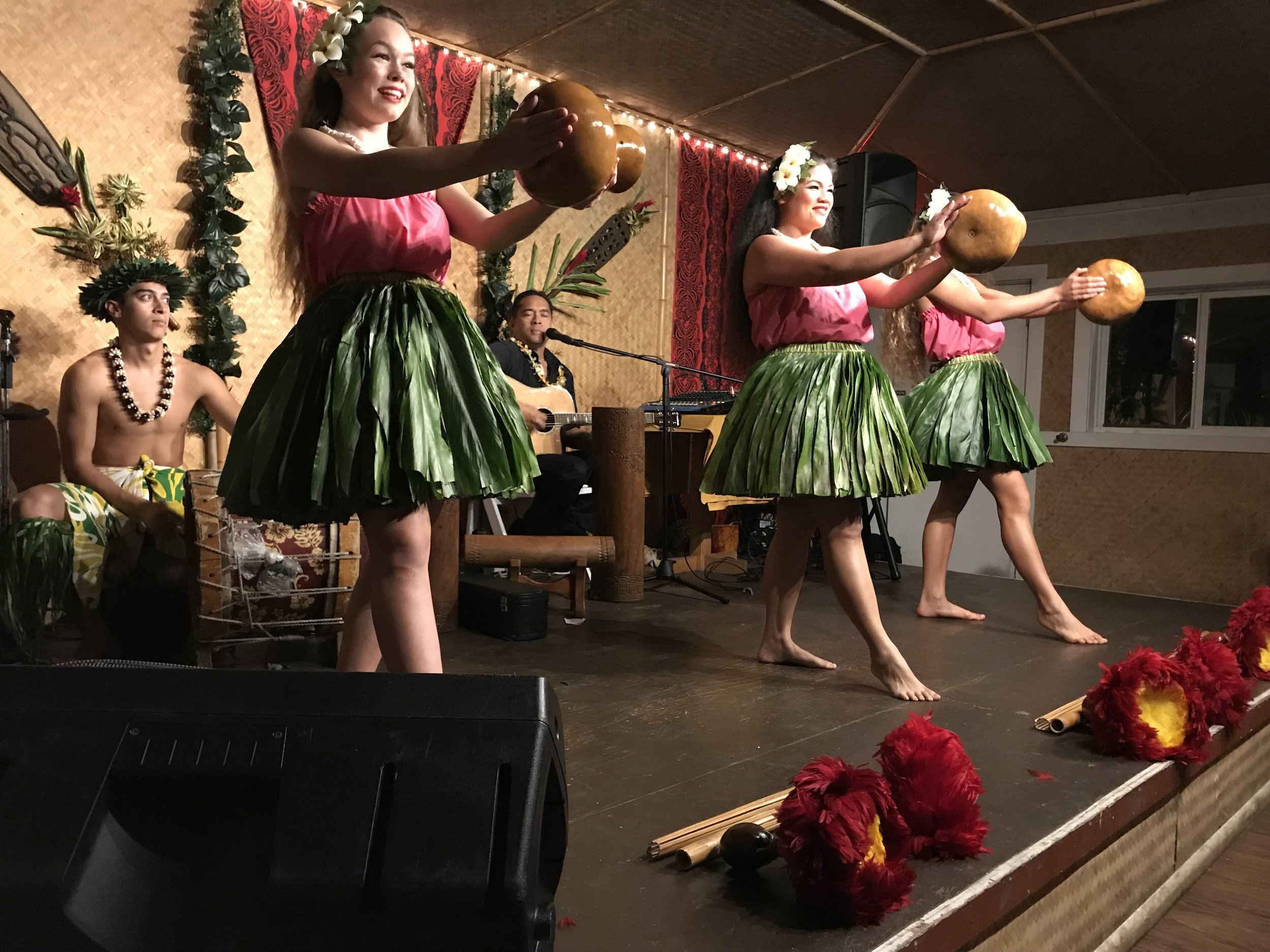 Hula dancers at the luau at Tahiti Nui restaurant in Hanalei on the Hawaiian island of Kauai.