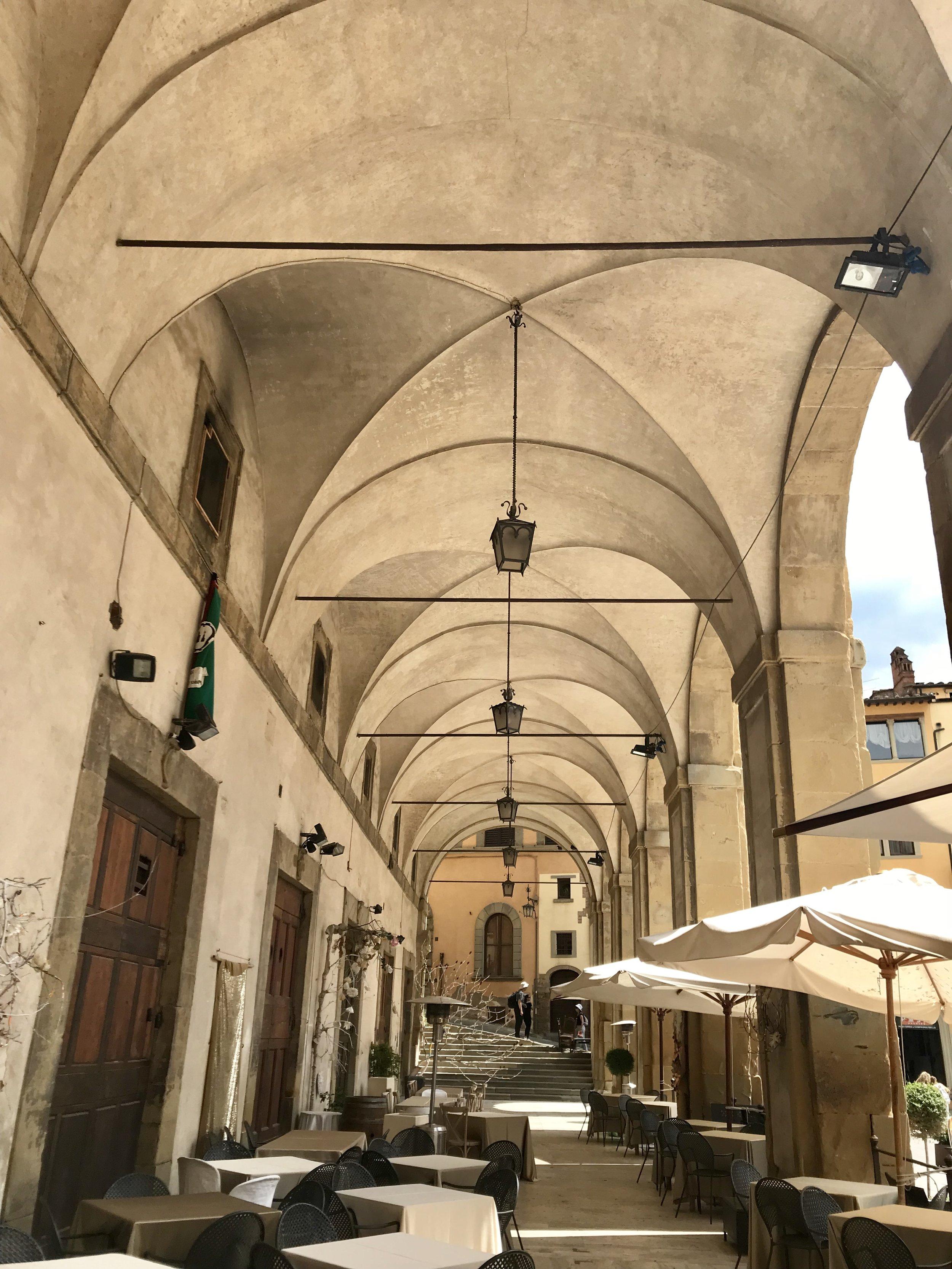 The loggia of the main piazza in Arezzo was designed by Vasari.