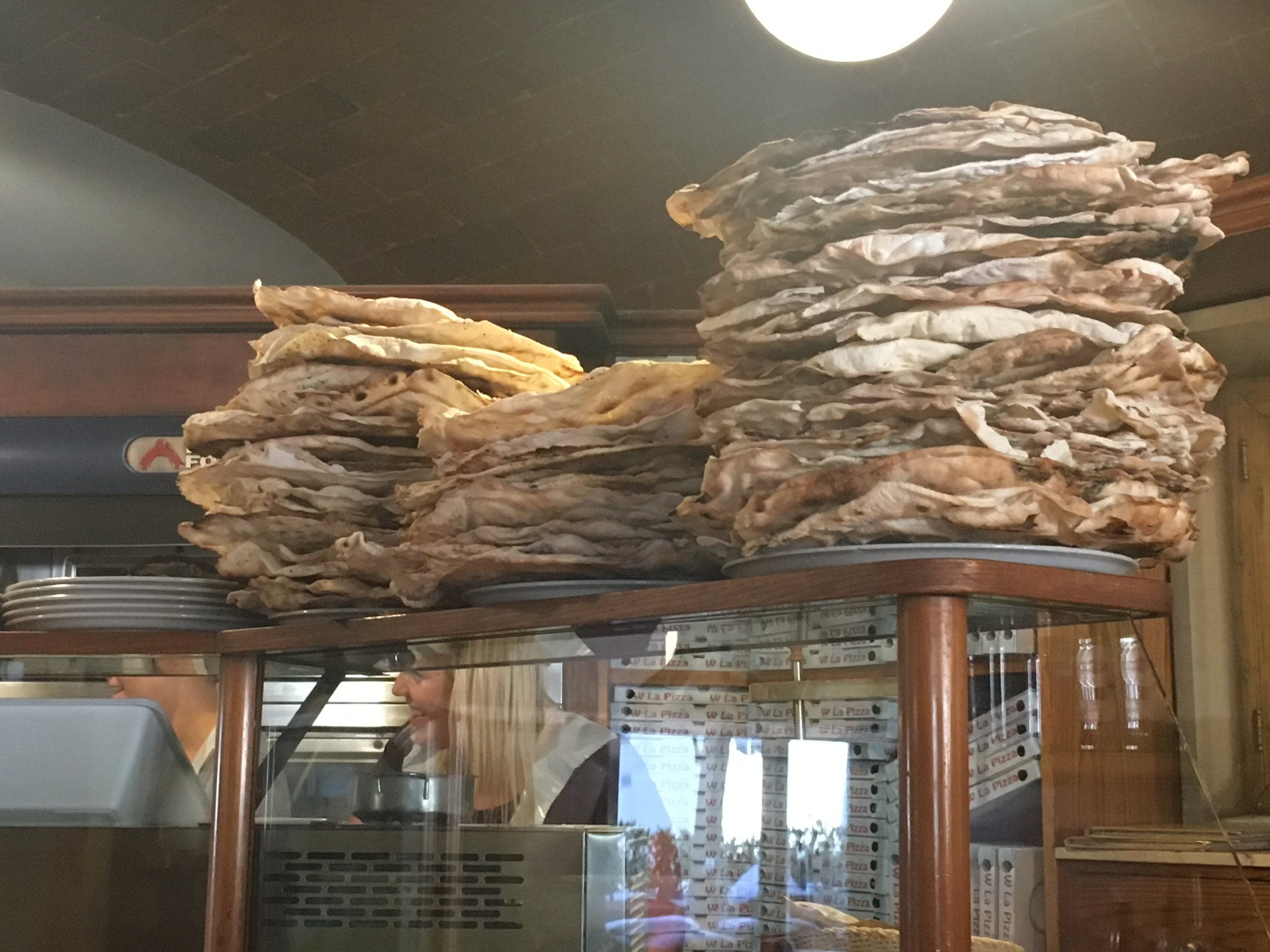 Crisp flat bread piled high in La Cantina, Greve