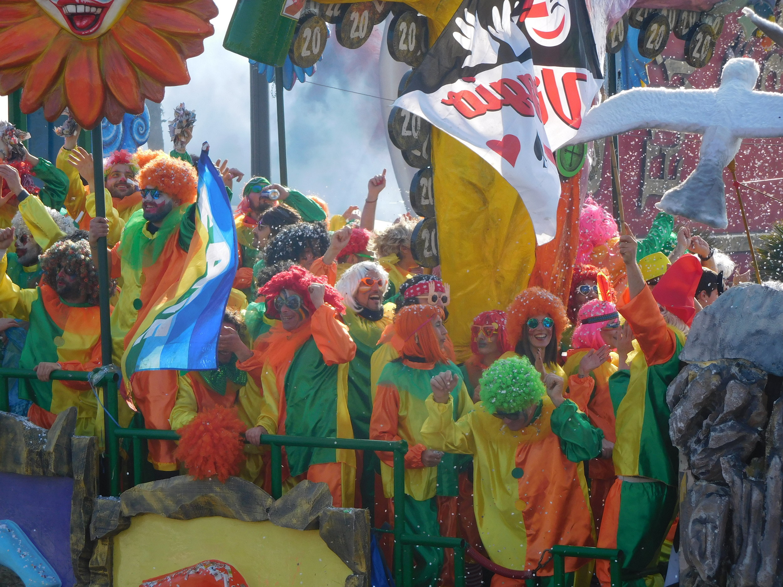 A rainbow float full of colorful clowns