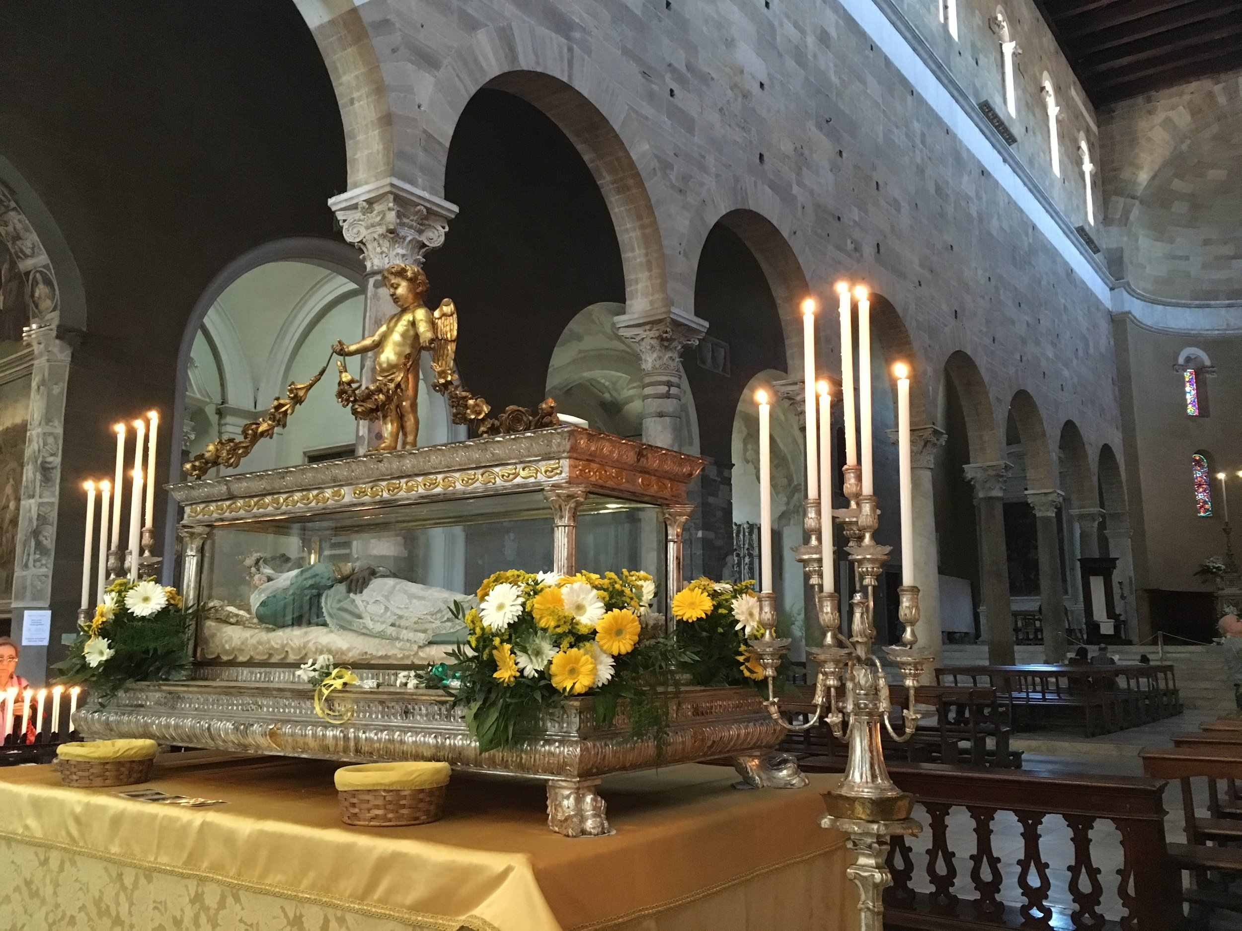 The body of Santa Zita is moved to the center of the cathedral of San Frediano during her annual celebration.