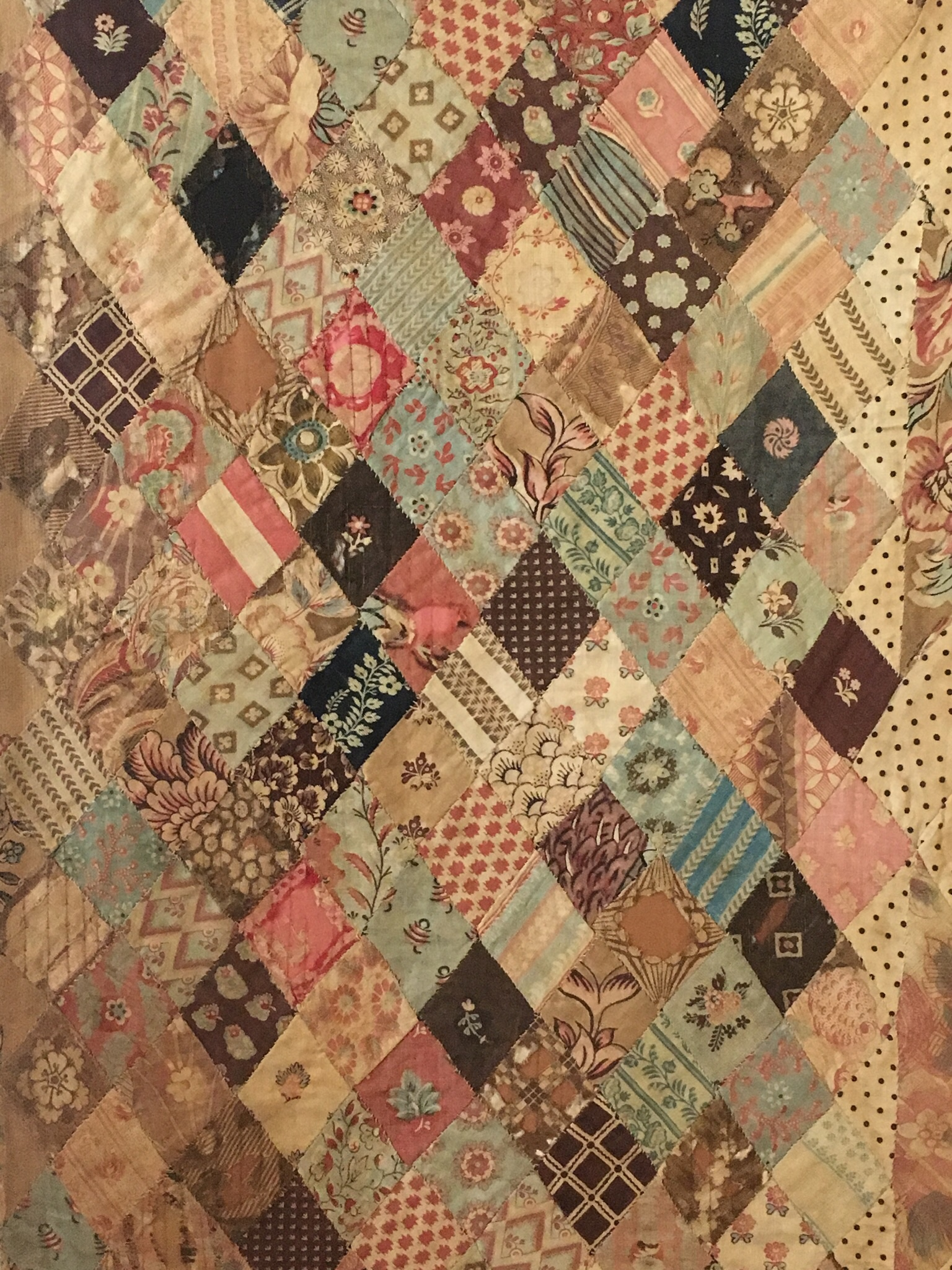 Close-up of the Austen family quilt (actually a coverlet rather than a quilt as it has no batting). The border alone contains 2,500 symmetrical diamond-shaped pieces, all hand-stitched.