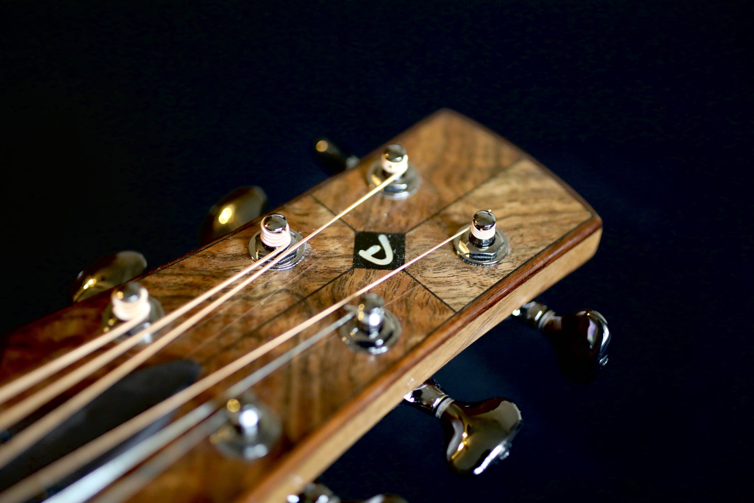 Four-Way Bookmatched Headstock with Decorative Binding