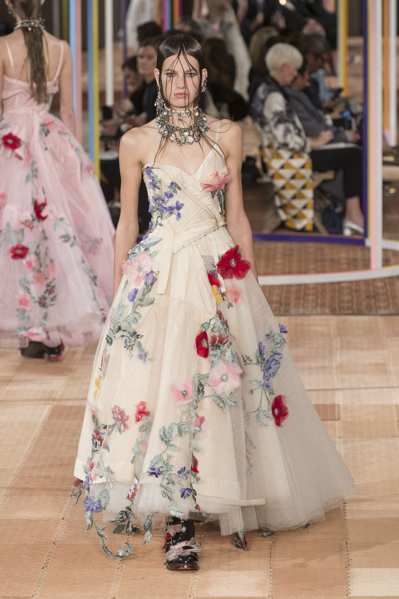 View photo source.    A full tulle skirt, a fitted bodice AND 3-D floral adornments? Where do we sign up!? The unexpected one-shoulder detail is a fun twist on a couture gown.