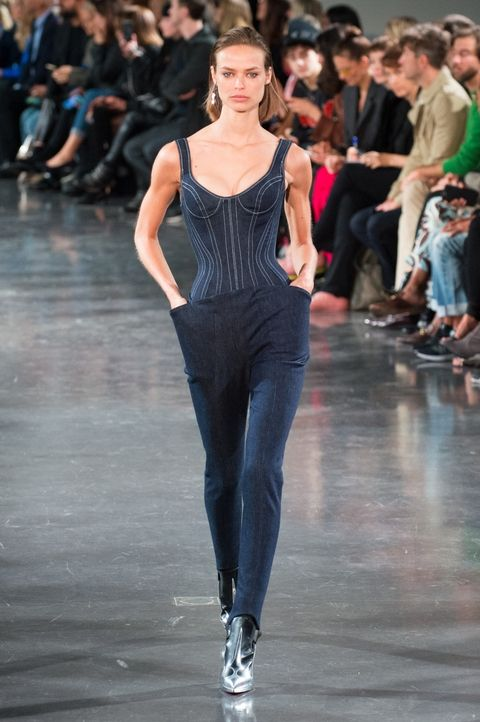 View photo source.    When done right, double denim is a major DO. This fitted bustier looks futuristic in the best way with the accompaniment of uniquely-shaped skinny trousers.