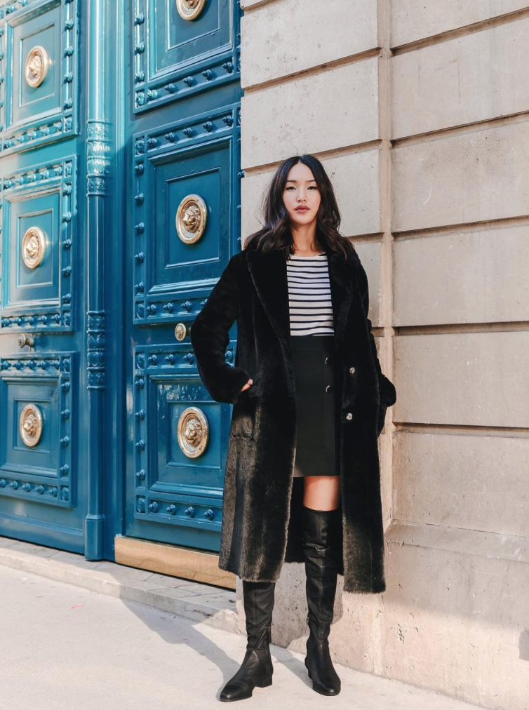View photo source.     How perfect is this classic look? We always suggest investing in high-quality pieces that will stand the test of time, so get your hands on a luxurious pair of tall boots and a soft striped tee!