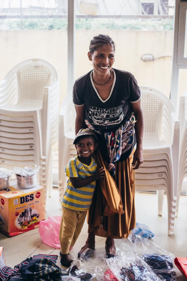 Bizunesh & her daughter Tinsae on the day she was launched into the GWE program. Bizunesh is now a thriving business owner who sells clothing and is able to provide for her five children and ensure they get a great education.