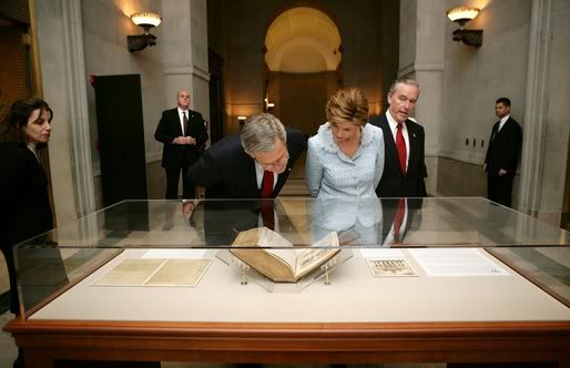President George W. Bush and Laura Bush tour the National Archives in Washington, D.C., Wednesday, Jan. 19, 2005 viewing the George Washington Inaugural Bible used by both Washington and his father, George H. W. Bush.