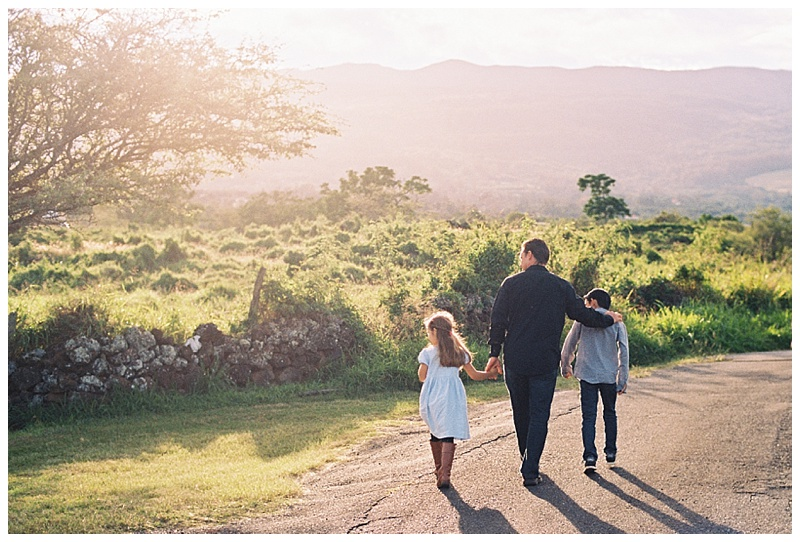 family-photographer-father-two-children-walking-down-road-holding-hands.jpg