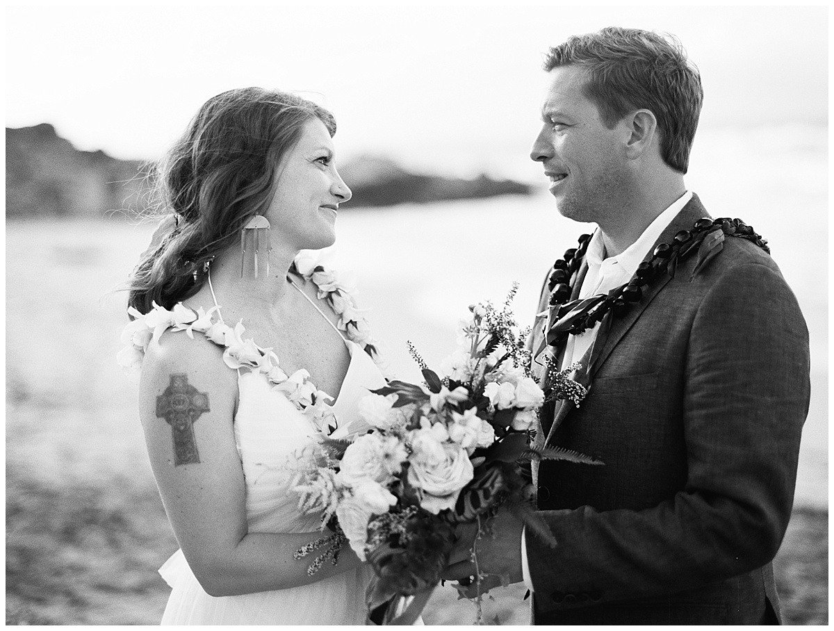 beach-elopement-black-and-white-bride-and-groom-looking-at-each-other.jpg