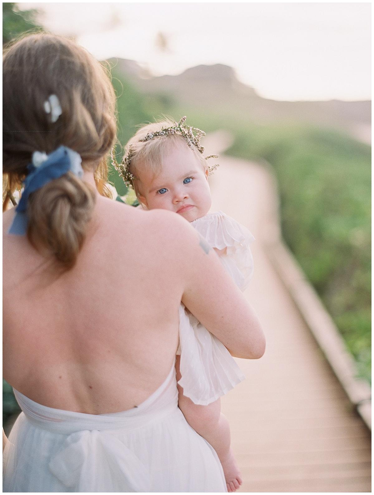 beach-elopement-bride-baby-girl-boardwalk.jpg