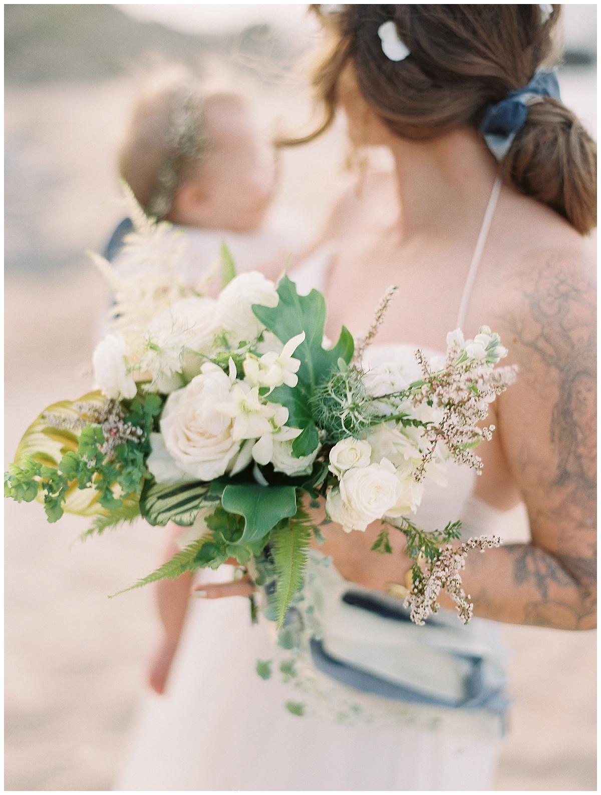 beach-elopement-bride-baby-girl-white-flower-bouquet.jpg