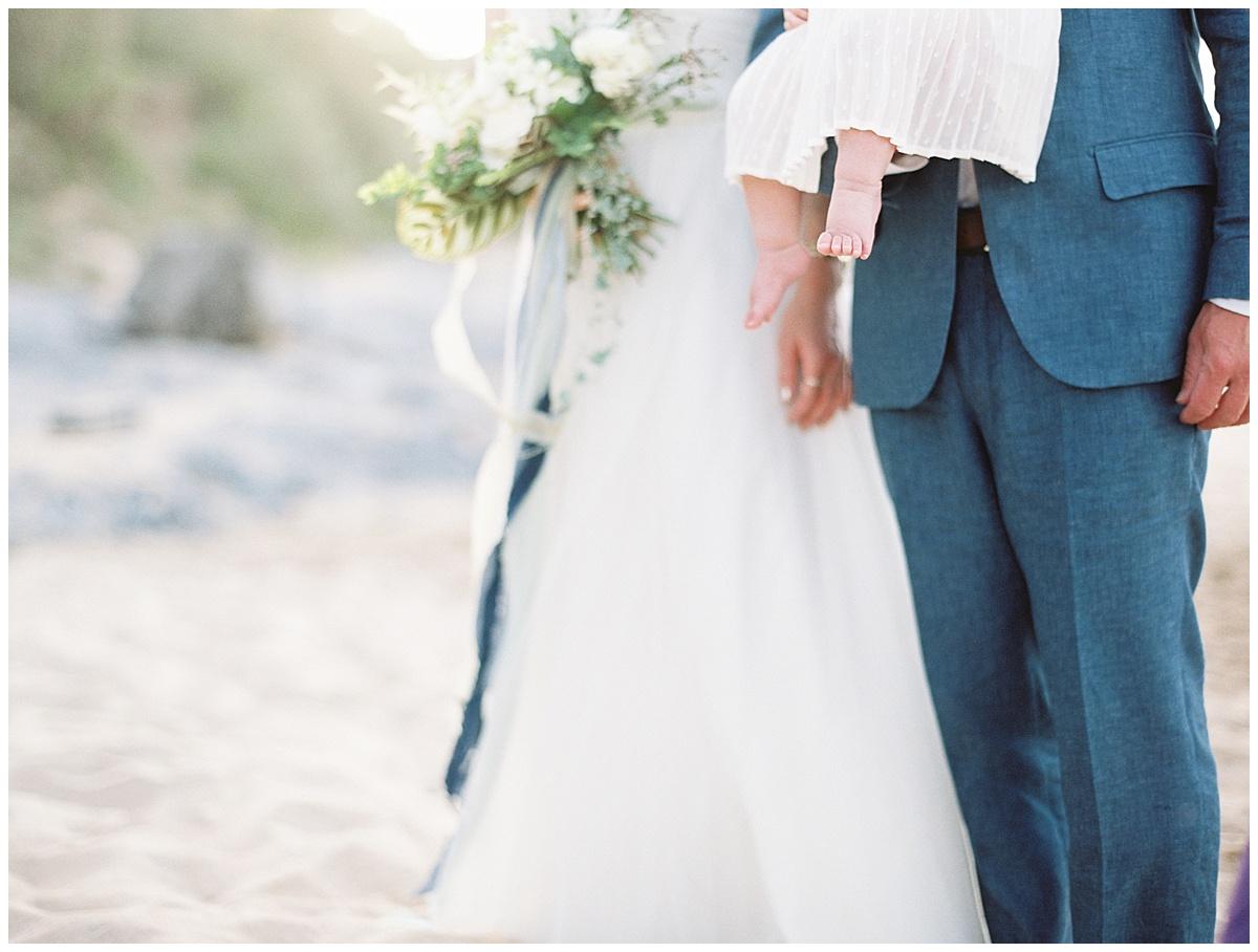 beach-elopement-bride-groom-baby-daughter-feet.jpg