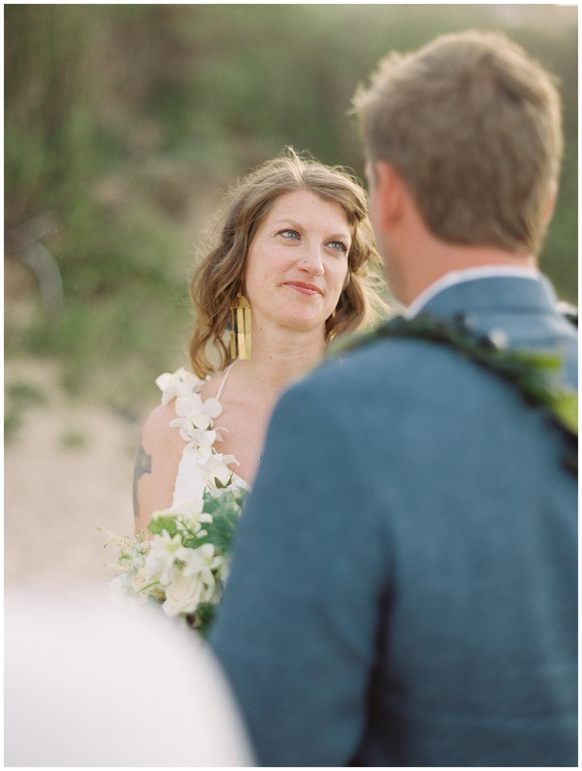 beach-elopement-bride-looking-at-groom-ceremony.jpg