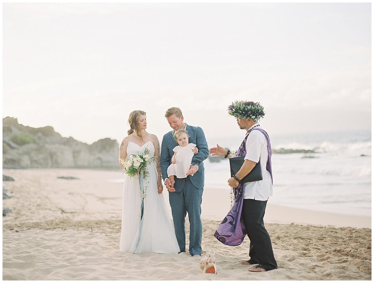 beach-elopement-ceremony-on-beach-rocks-water-conch-shell.jpg