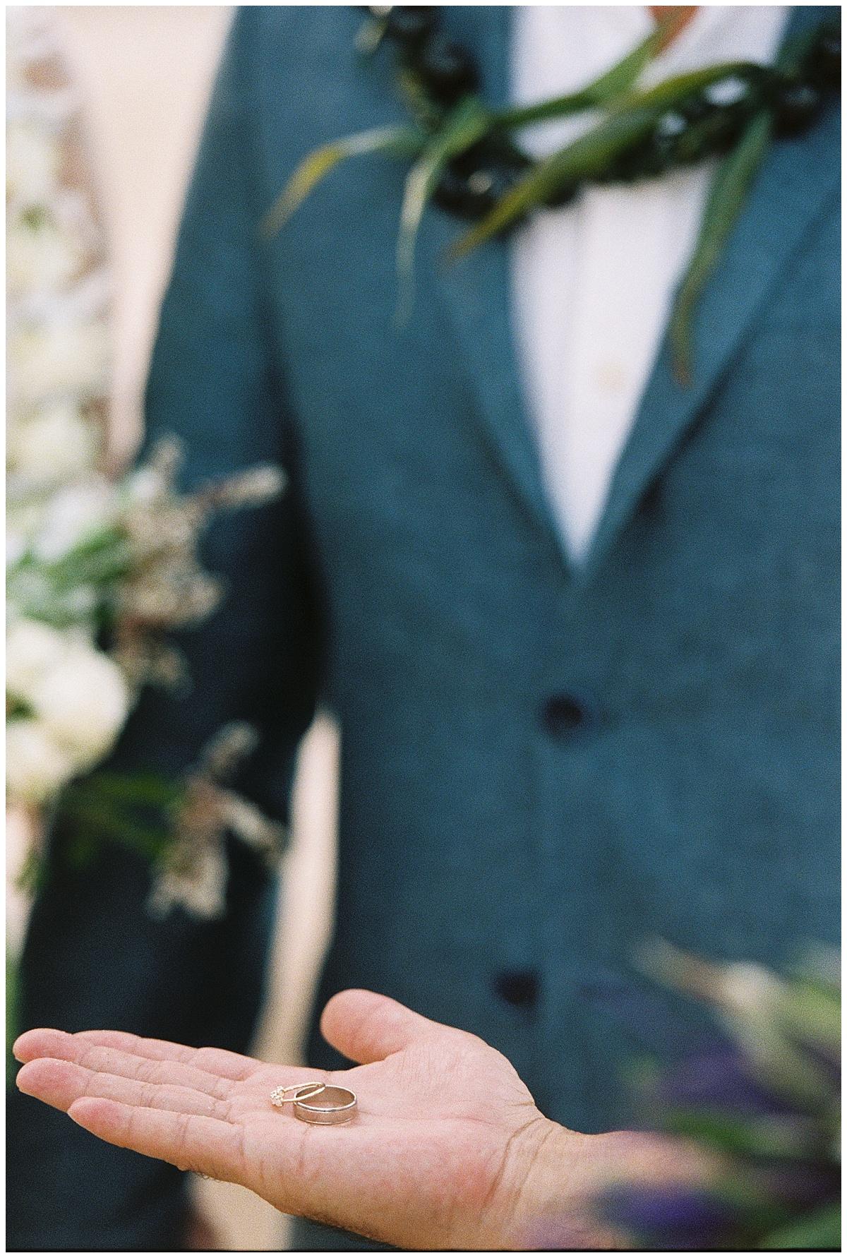 beach-elopement-ceremony-rings-blue-suit.jpg