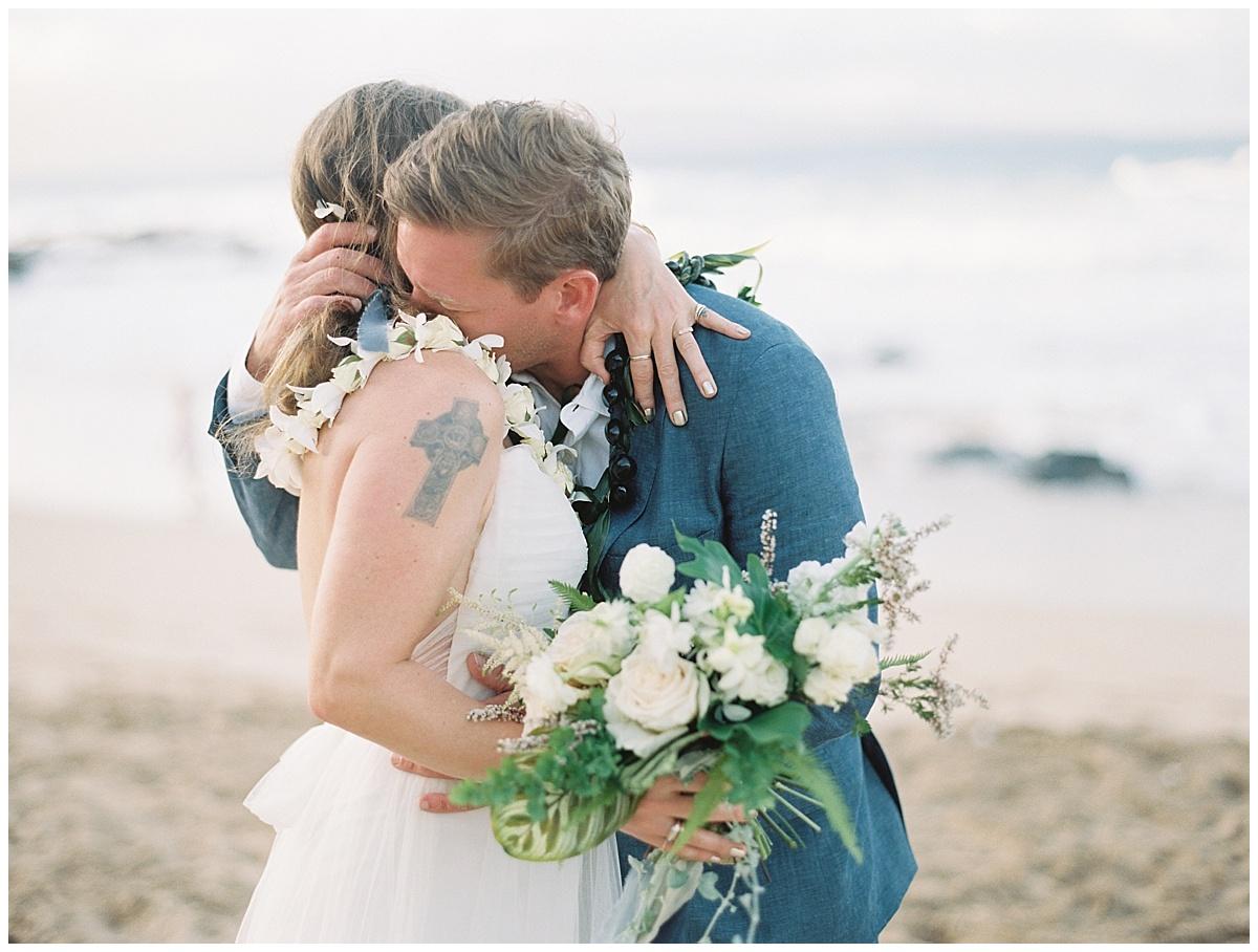 beach-elopement-maui-bride-groom-ceremony-embrace-hug.jpg