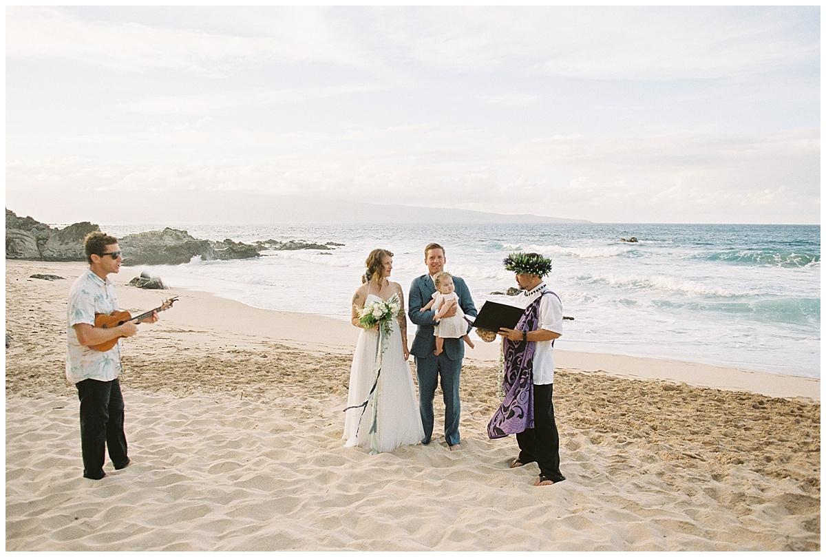 beach-elopement-maui-ironwoods-beach-ceremony-hawaiian-officiant-ukulele-player.jpg