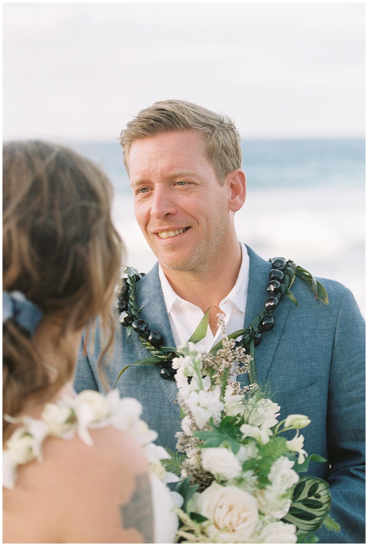 beach-elopement-maui-ironnwoods-beach-ceremony-groom-looking-at-bride.jpg