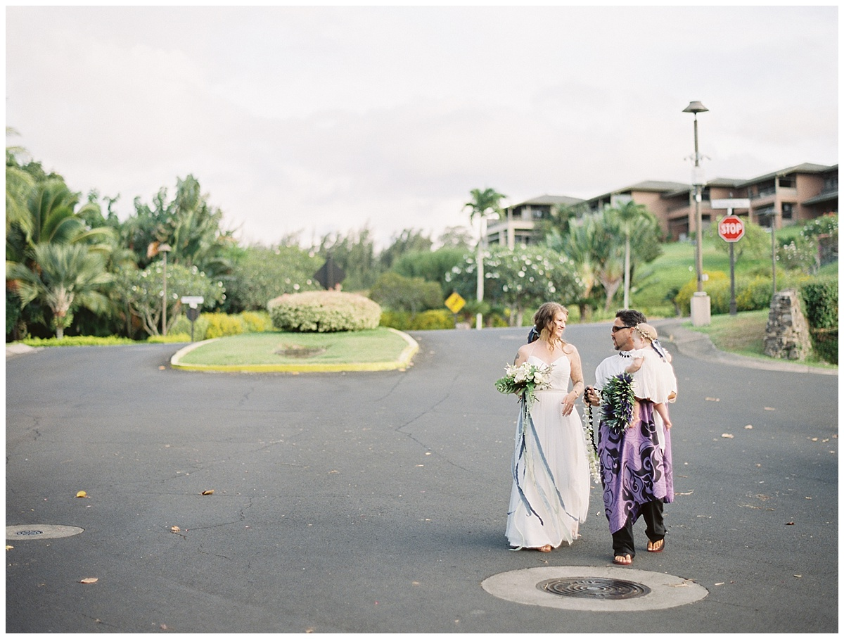 beach-elopement-parking-log-hawaii-officiant-with-bride-and-baby.jpg