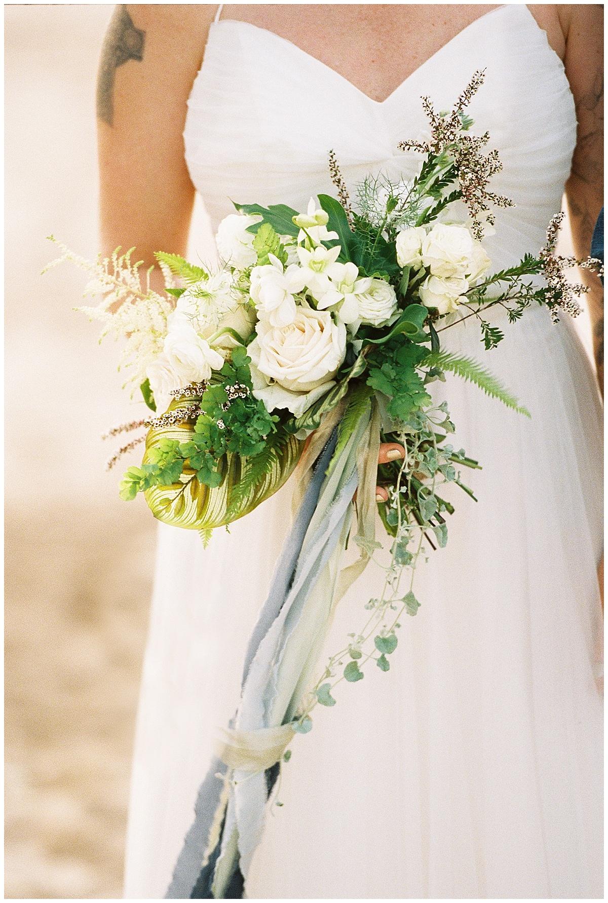 beach-elopement-white-flower-bouquet-blue-ribbon.jpg